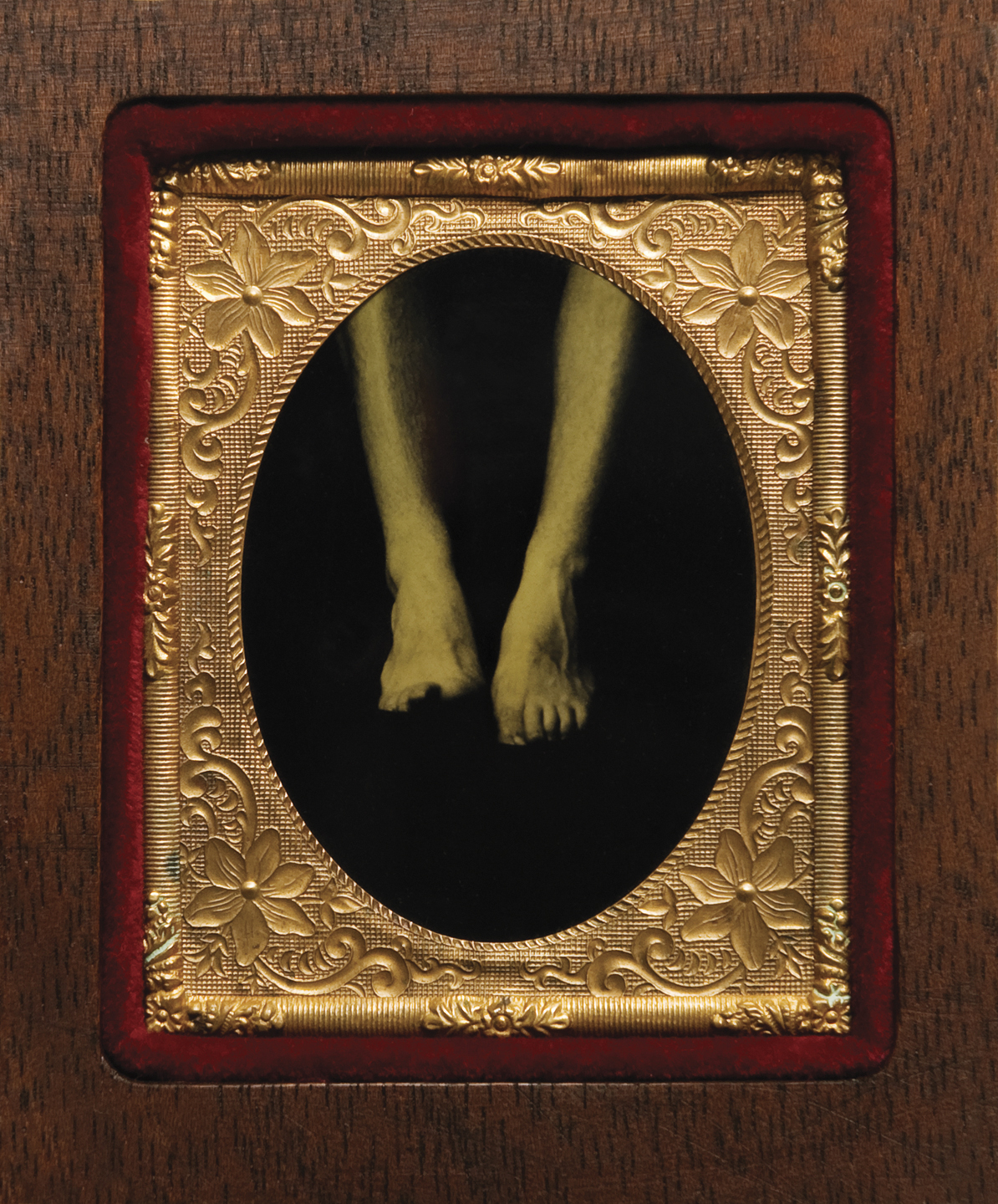 "From ""Self Portraits by Heterosexual Men"" Ambrotype in 19th–century brass mat and preservers with velvet trim and custom-made mahogany frame, 3 1/8"" x 2 3/4"", 1996–98"