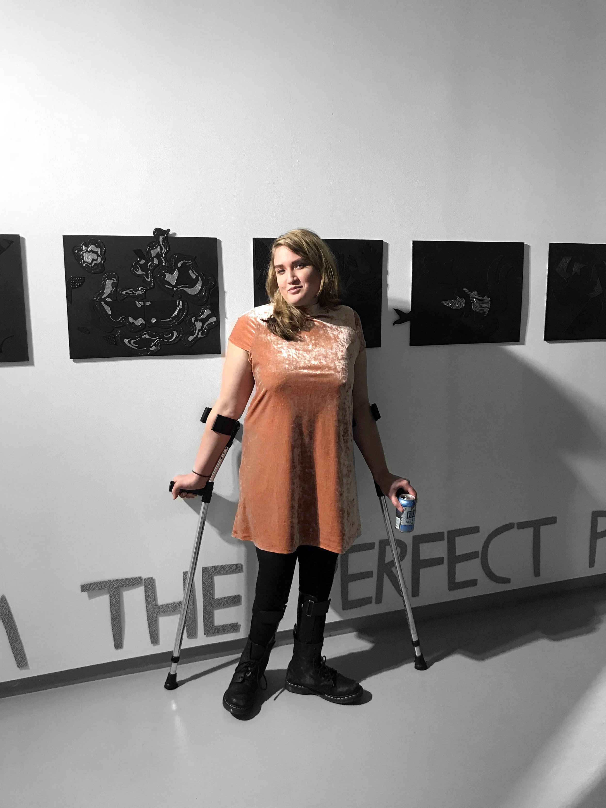 2018, Madison Zalopany in front of her tactile magnetic paintings at the Dedalus Foundation. Photo credit Adam Rose