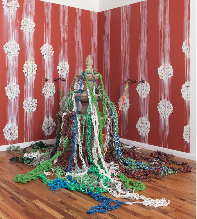 """The Intrepid Garden II,"" 2018, painted sweet asylum flowers, crocheted rope, fountain, dimensions variable"