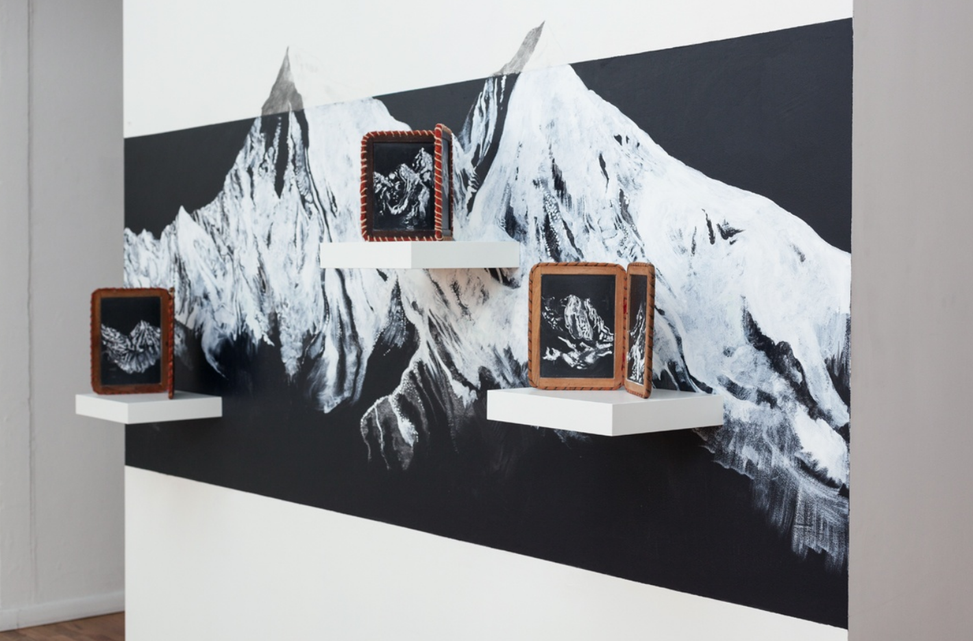The Right Place ( views of mountain ranges I have spent time with), 2018, vintage school house slates, chalk, graphite, acrylic, shelves, dimensions variable