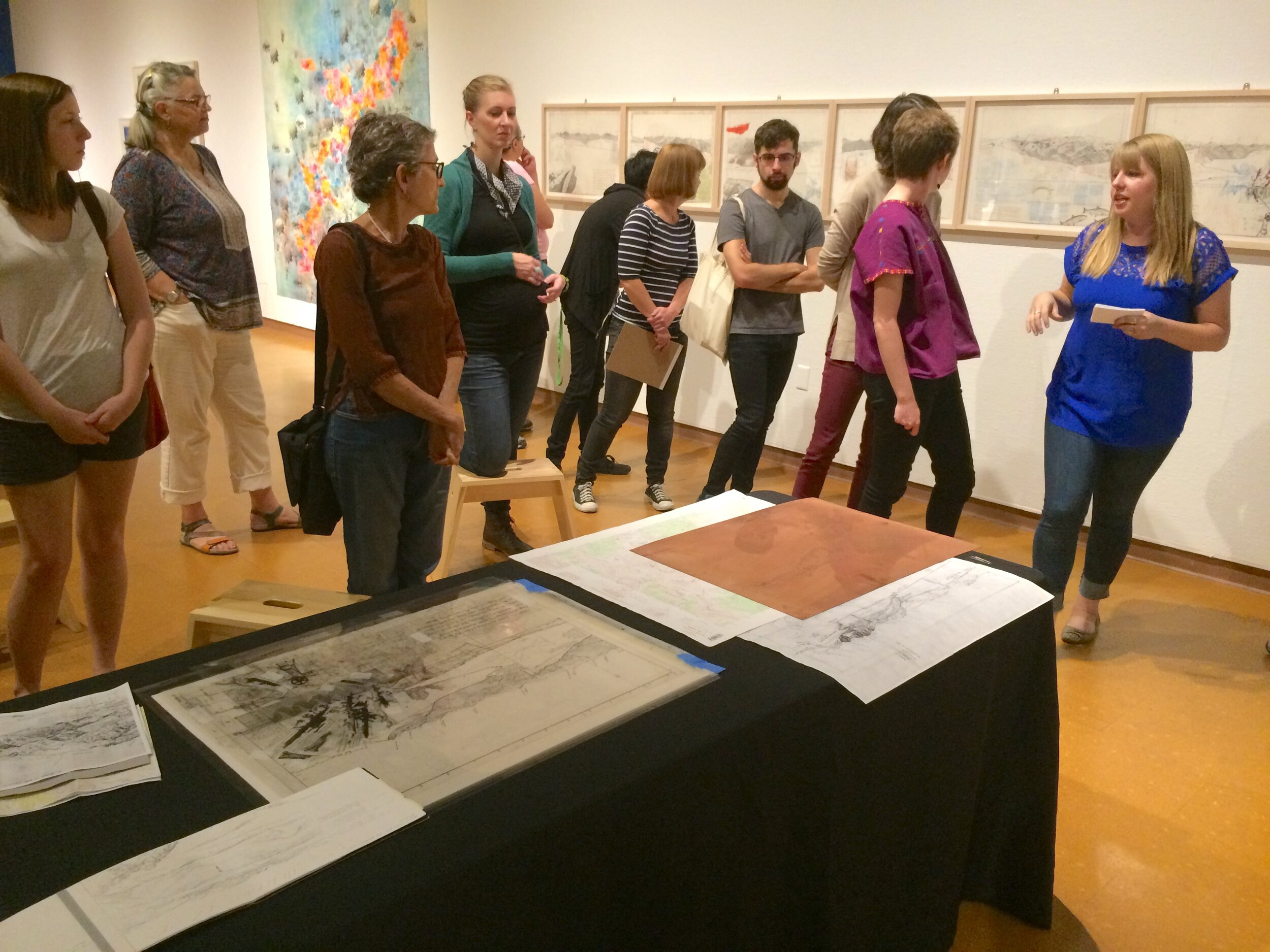 Artist Katelyn Bladel leading a printmaking demo and conversation.