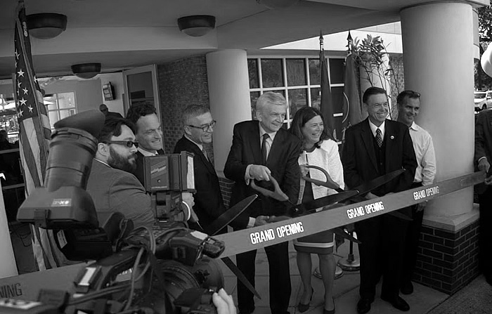 Ribbon cutting. From left: UNO Student Government President David Teagle, Consul General of FranceGrégor Trumel, Dr. Anton Fink, Ambassador Hans Peter Manz, Alea Cot, Peter J. Fos, Steve Striffler.
