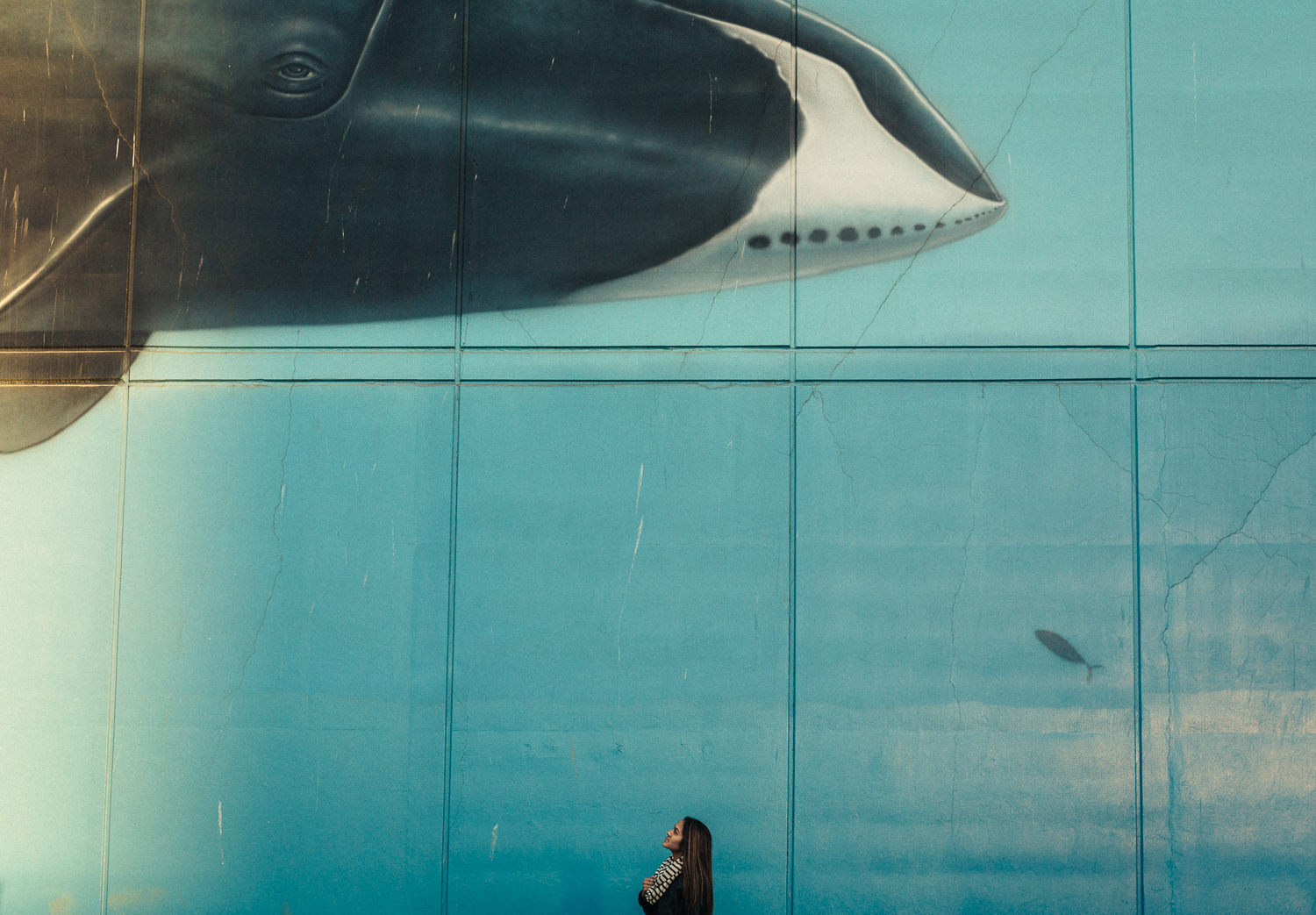 Portrait in Anchorage in front of orca mural