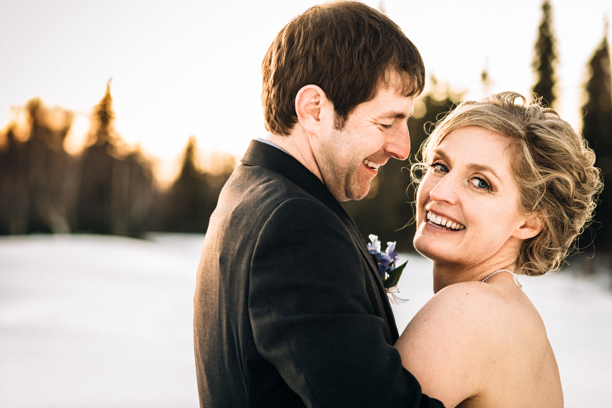 Couple enjoying first sunset as husband and wife in Anchorage