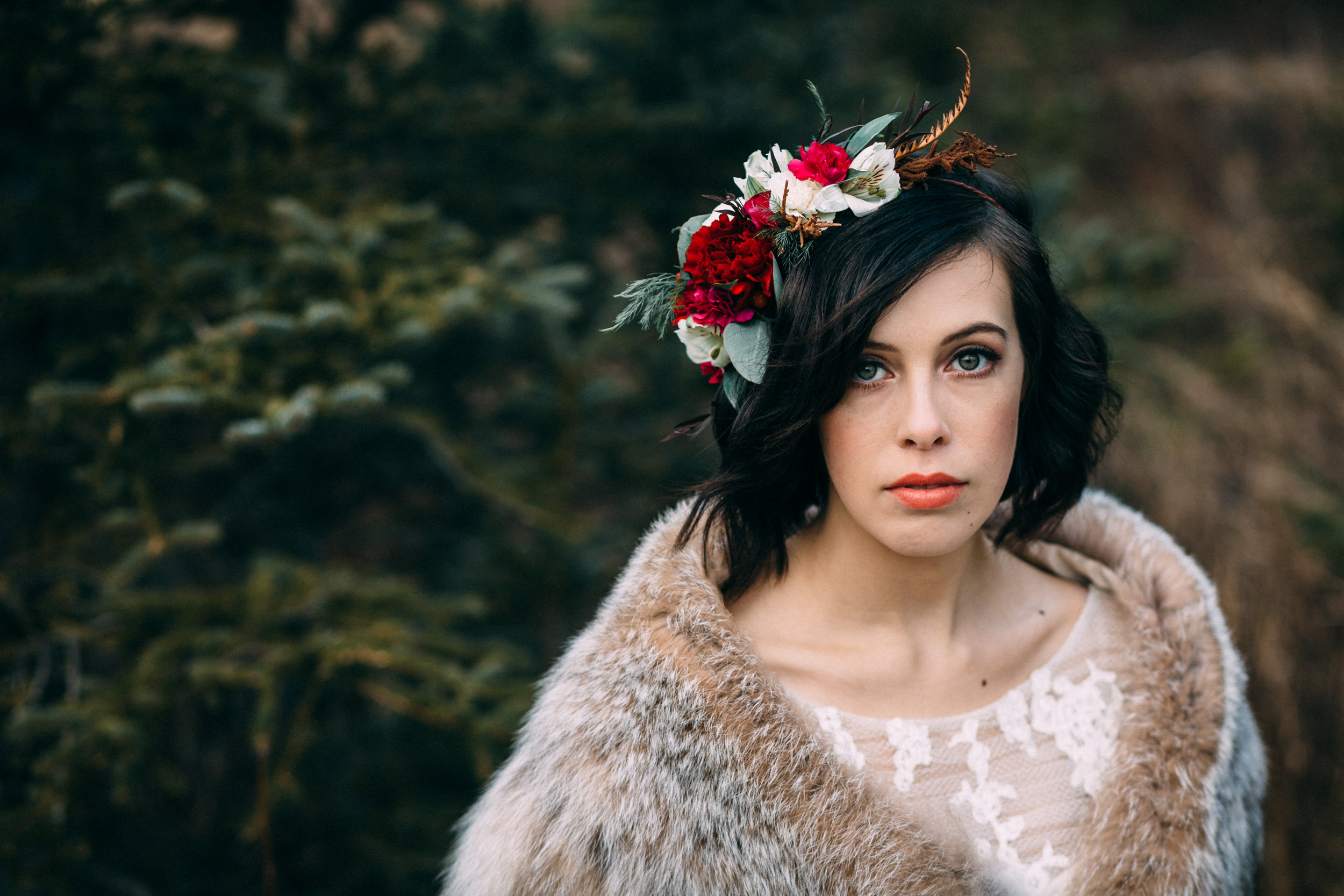 Bride with vibrant flower crown and lynx shawl