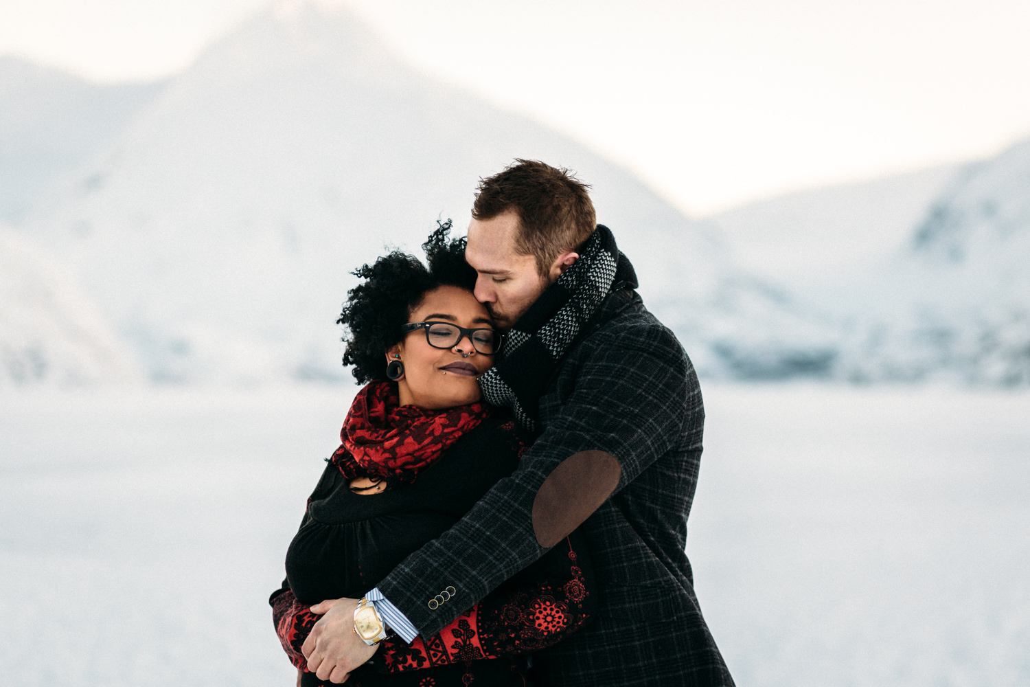 Couple staying warm during snowy Alaskan weather