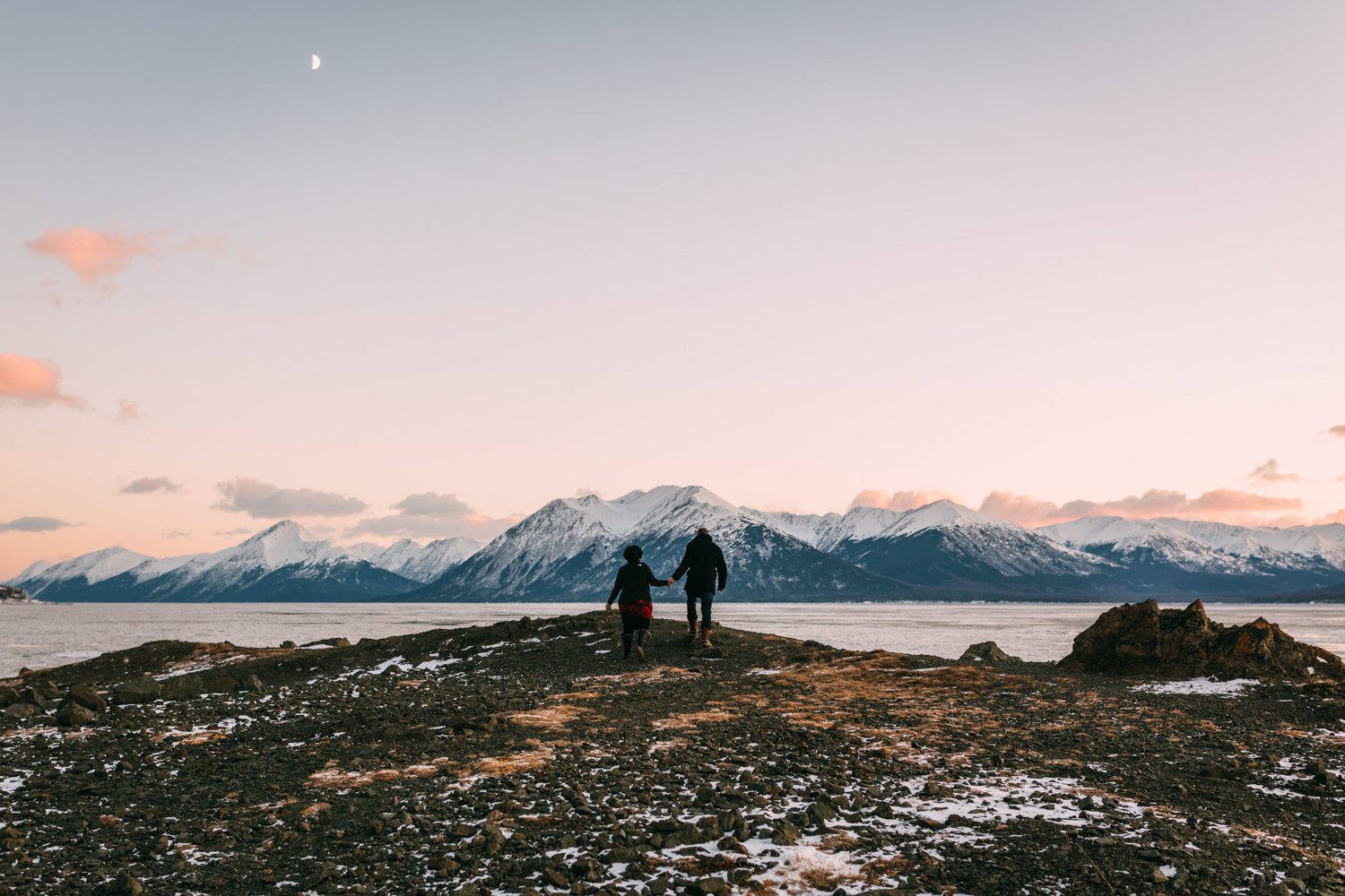 Engaged couple at Beluga Point during winter sunset