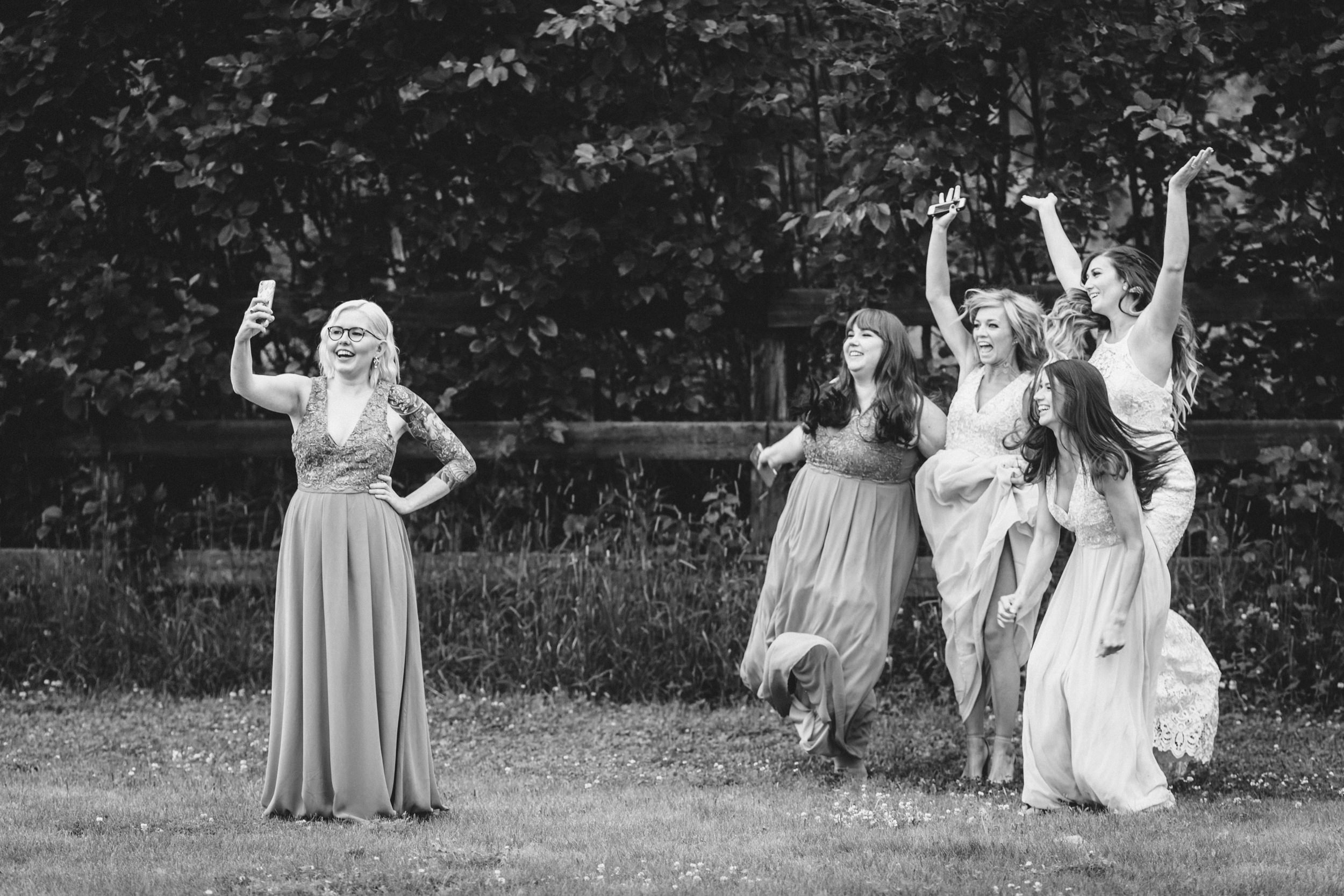 Alaskan bridesmaids posing for a jump photo