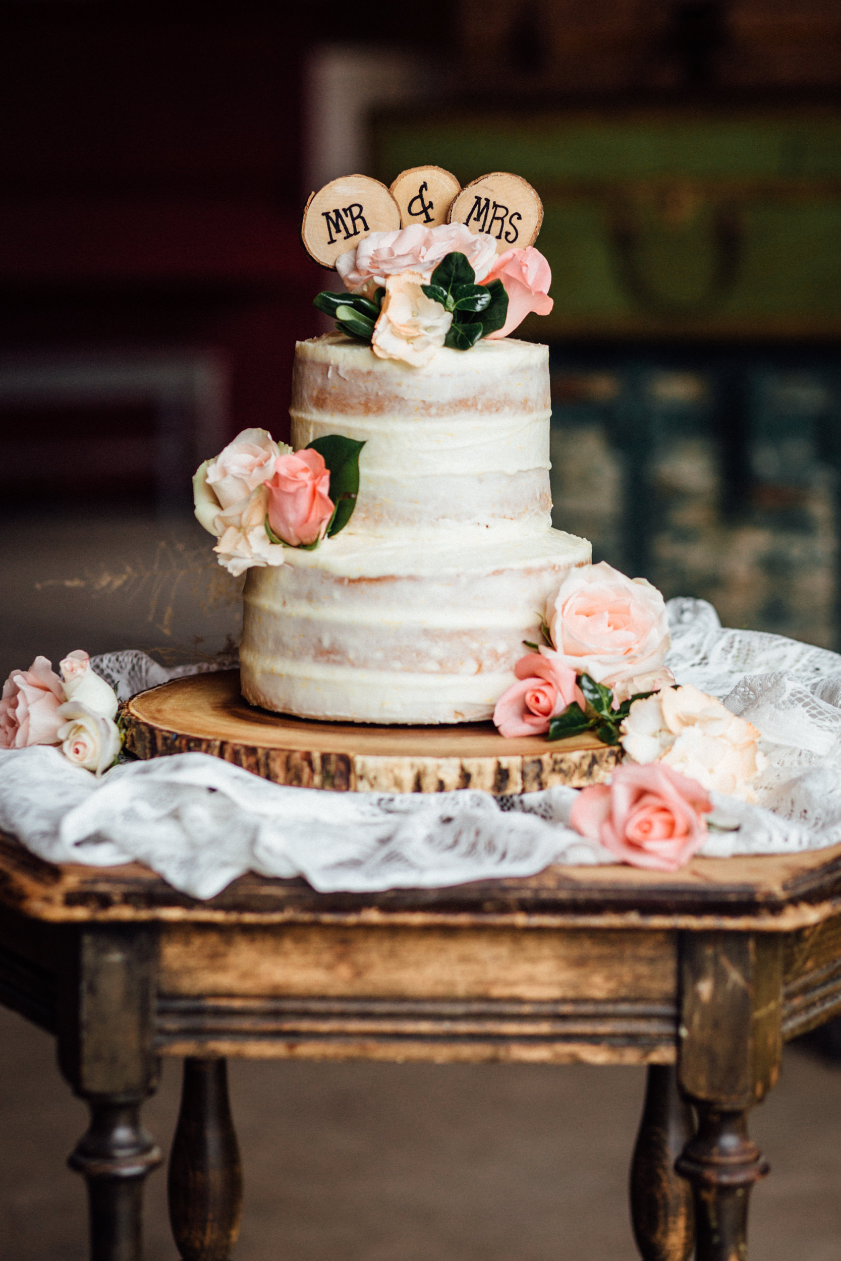 Three-layer wedding cake with pink flowers