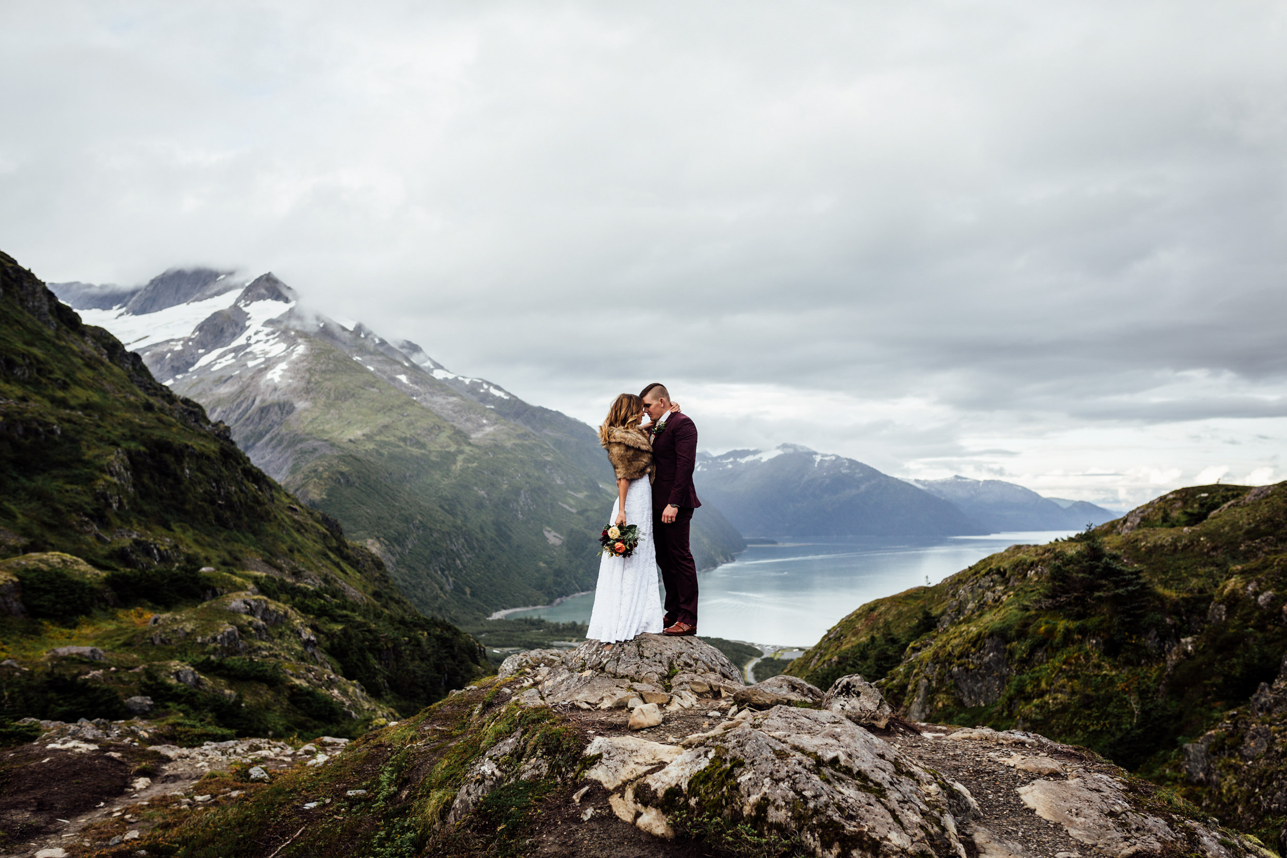 couple atop mountain peak