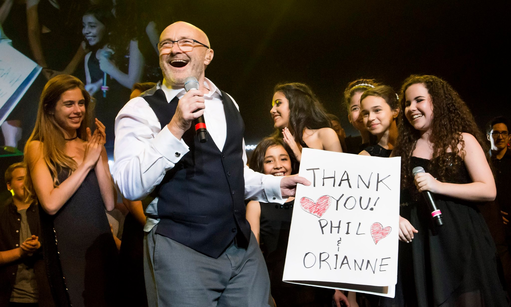 Phil Collins with with the talented young performers. Photo: Magical Photos/Mitchell Zachs
