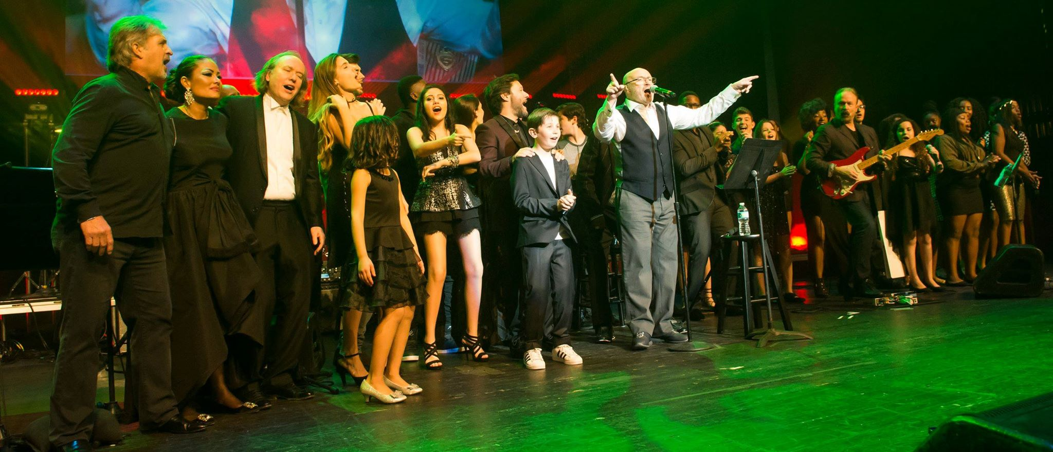 Encore! Phil Collins on stage with the children and the celebrities who came out to support the cause. Photo: Magical Photos/Mitchell Zachs