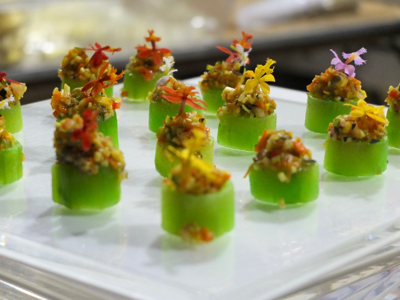 Vegan Hors D'oeuvres: Veggie Tartar in Cucumber Cup with a Micro Flower