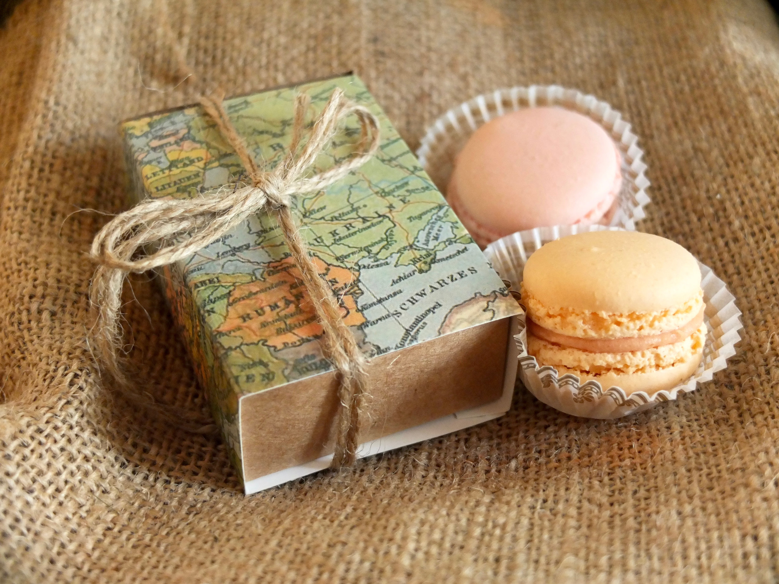 Each place setting included an adorable macaroon gift box wrapped in vintage-style maps.