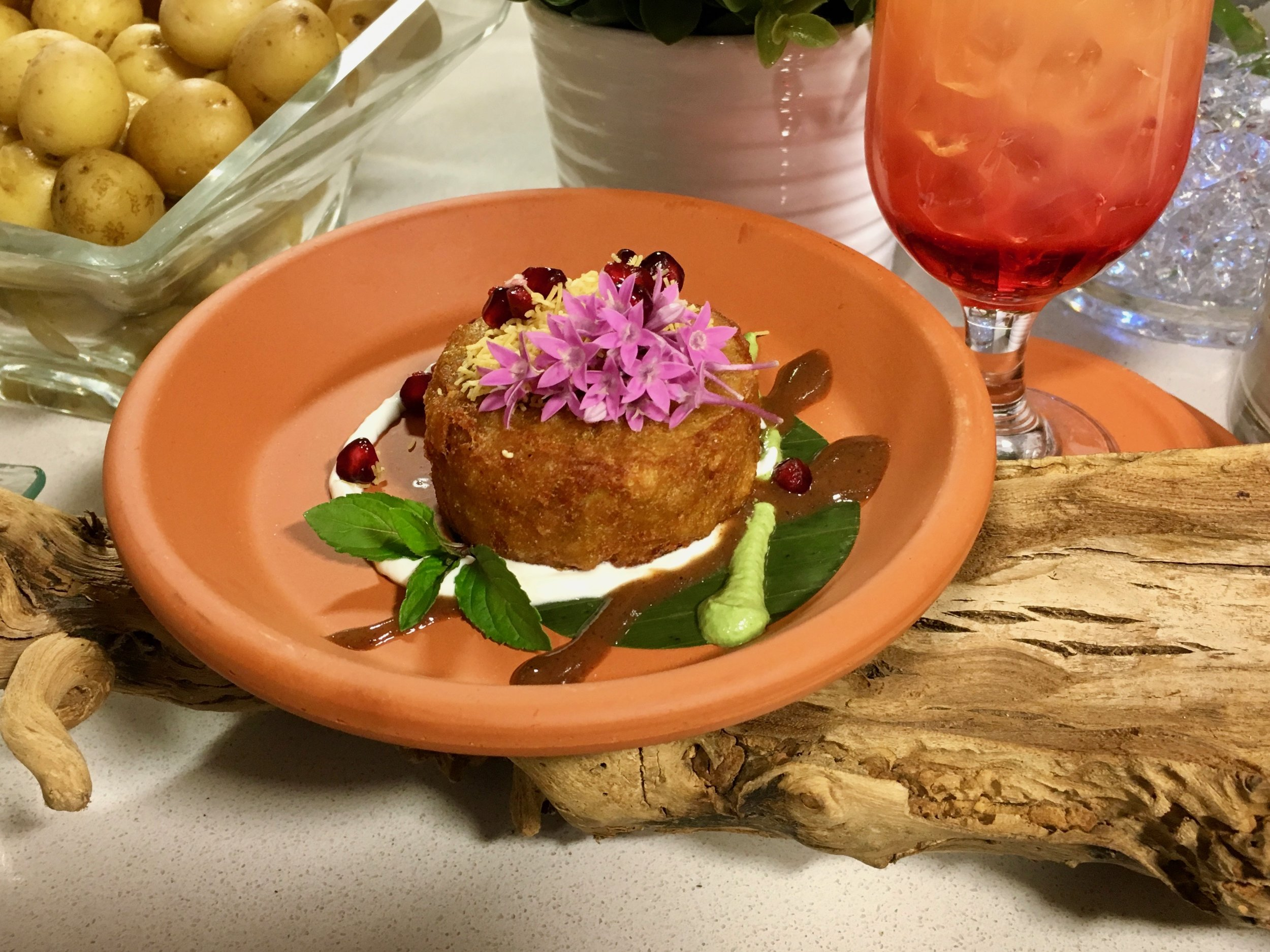 Tikki Chaat (Potato Curry Cake) served with Tamarind Sauce & Cool Mint Crème   Garnished with Crispy Lentil Threads and Pomegranate Seeds. Authentic Indian cusine is also increasingly popular and features many flavorful vegetarian recipes.