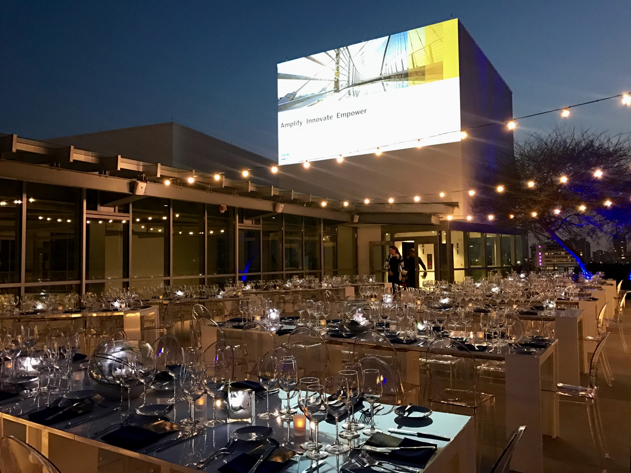 Set up for a corporate dinner on the rooftop of the New World center