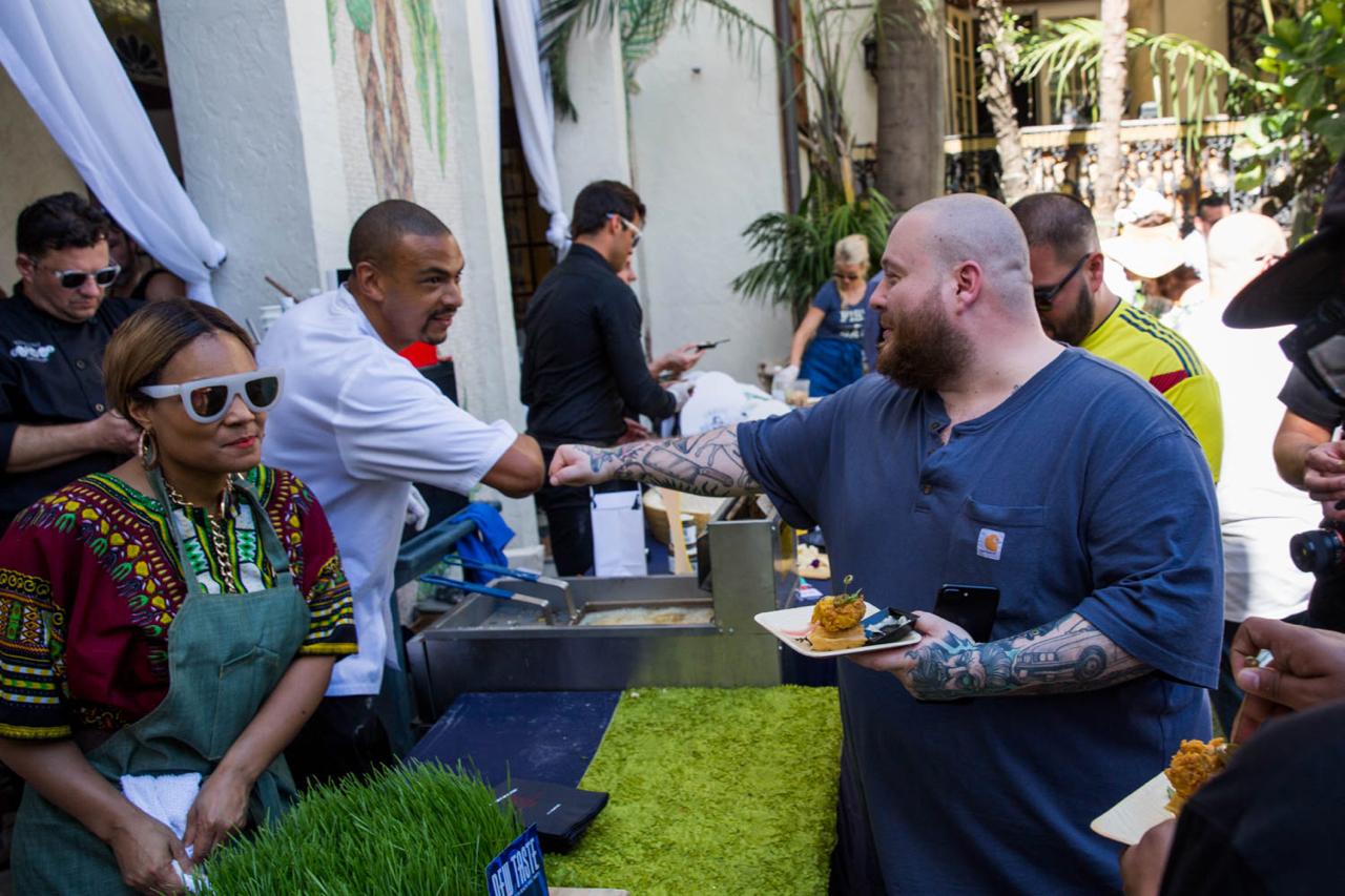 Chef Aamaris Jone greets Action Bronson