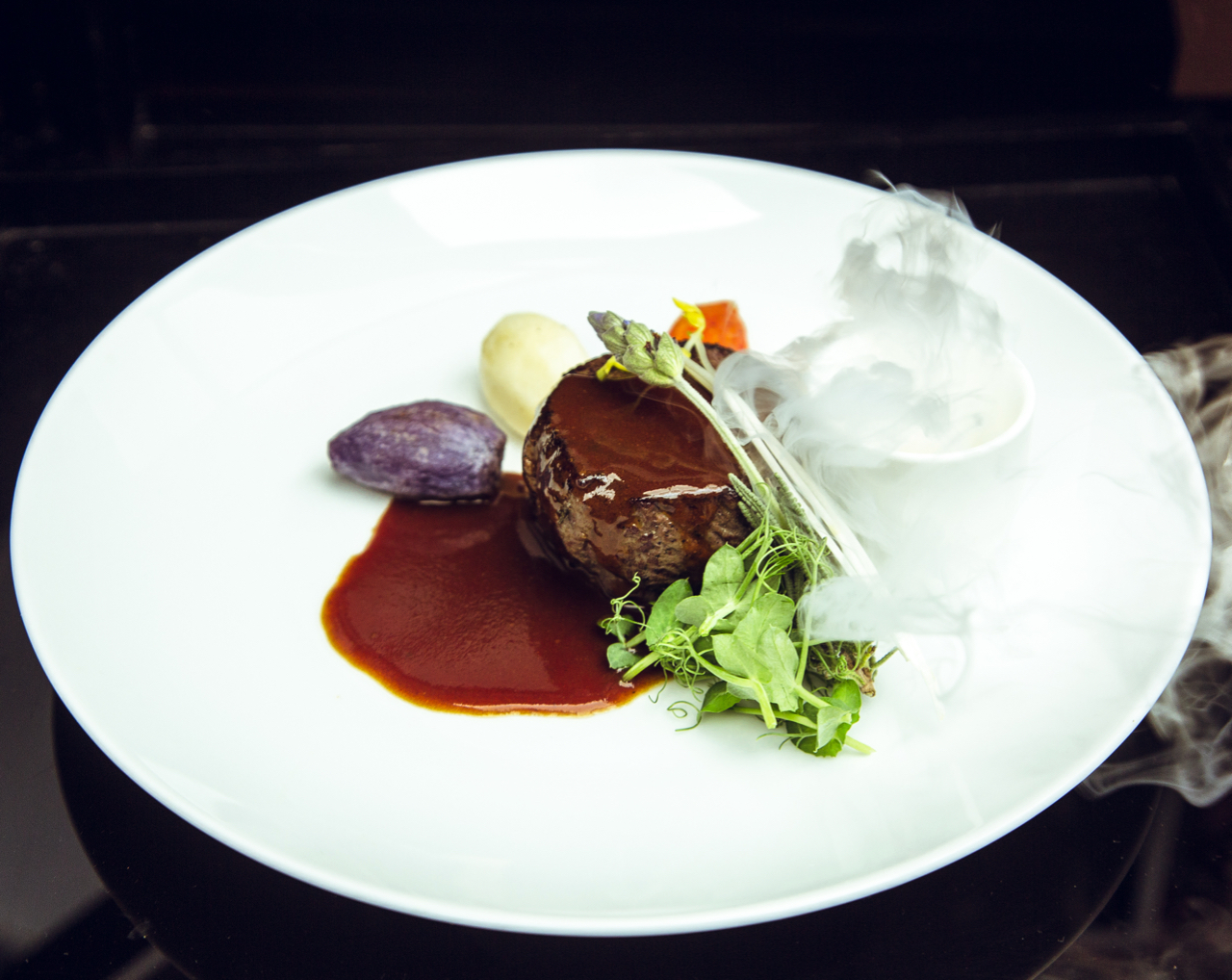 VENISON LOIN, Paired with The Macallan M (Under Cloche, Sauced Tableside,) Scotch Whisky & Herb Fog, Sauce Perigueux, Vegetable Bouquetiere