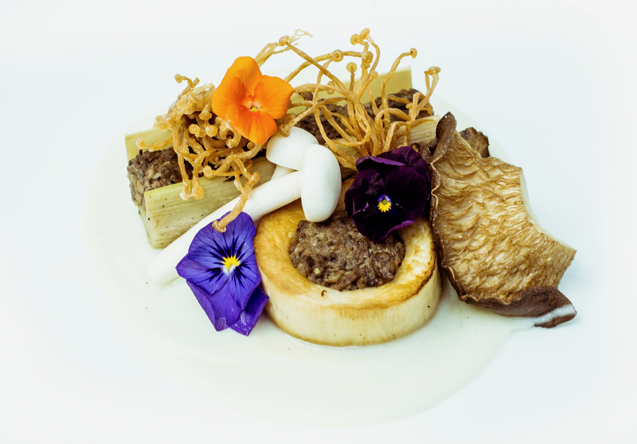 """VEGAN """"OSSO BUCO,"""" Paired With The Macallan No. 6 - Truffle Cauliflower Puree, Heart of Palm, Pickled Mushroom, Roasted King Oyster"""