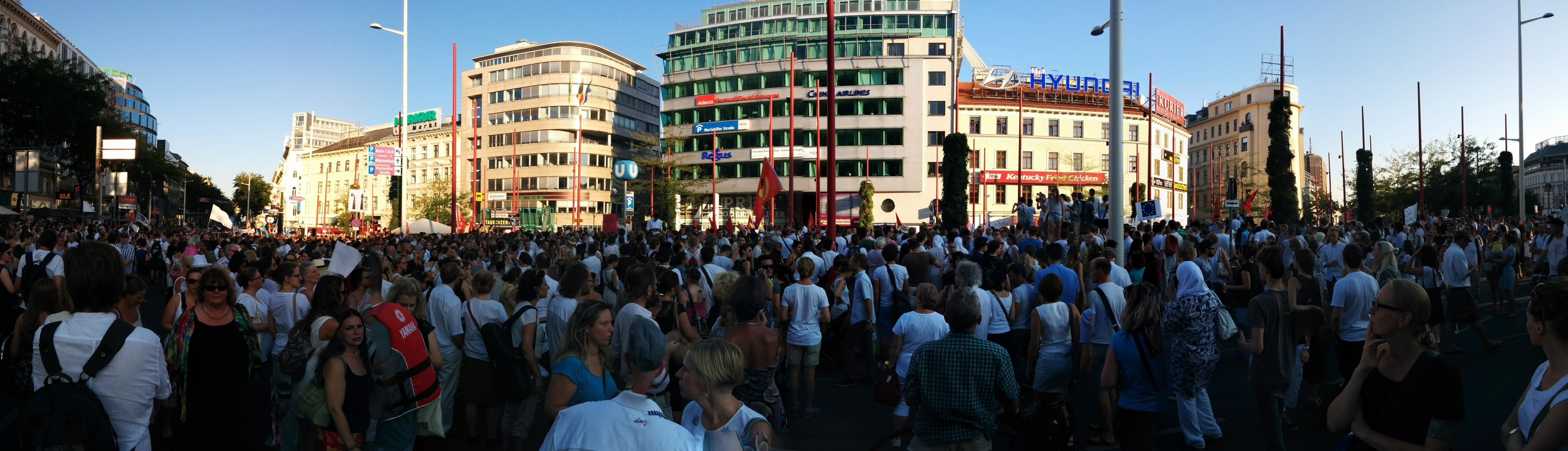 Some of an estimated 20,000 people engaging with their social environment at a demonstration for refugees in Vienna on 31 August 2015.