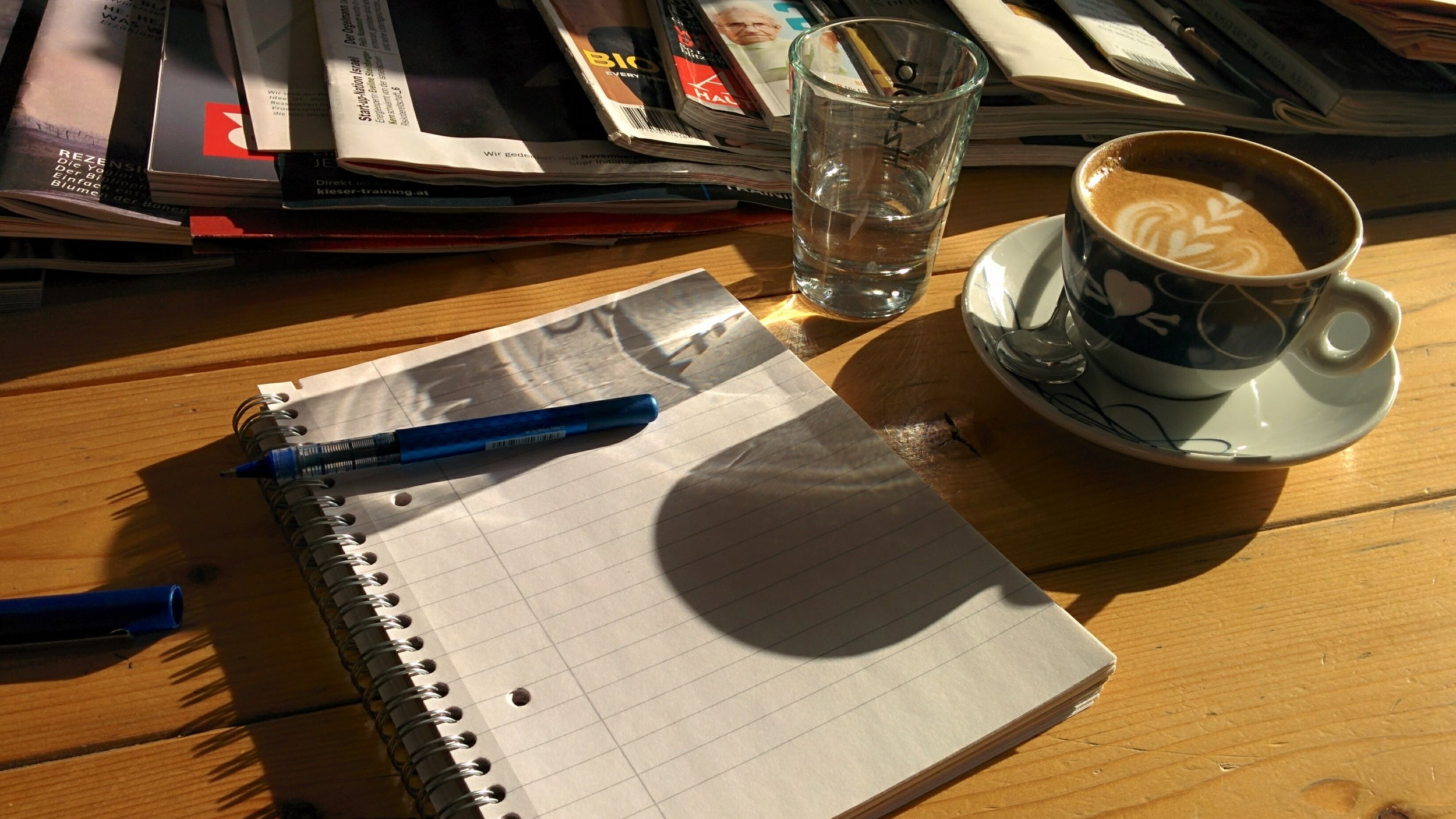 Coffee, water and a notepad