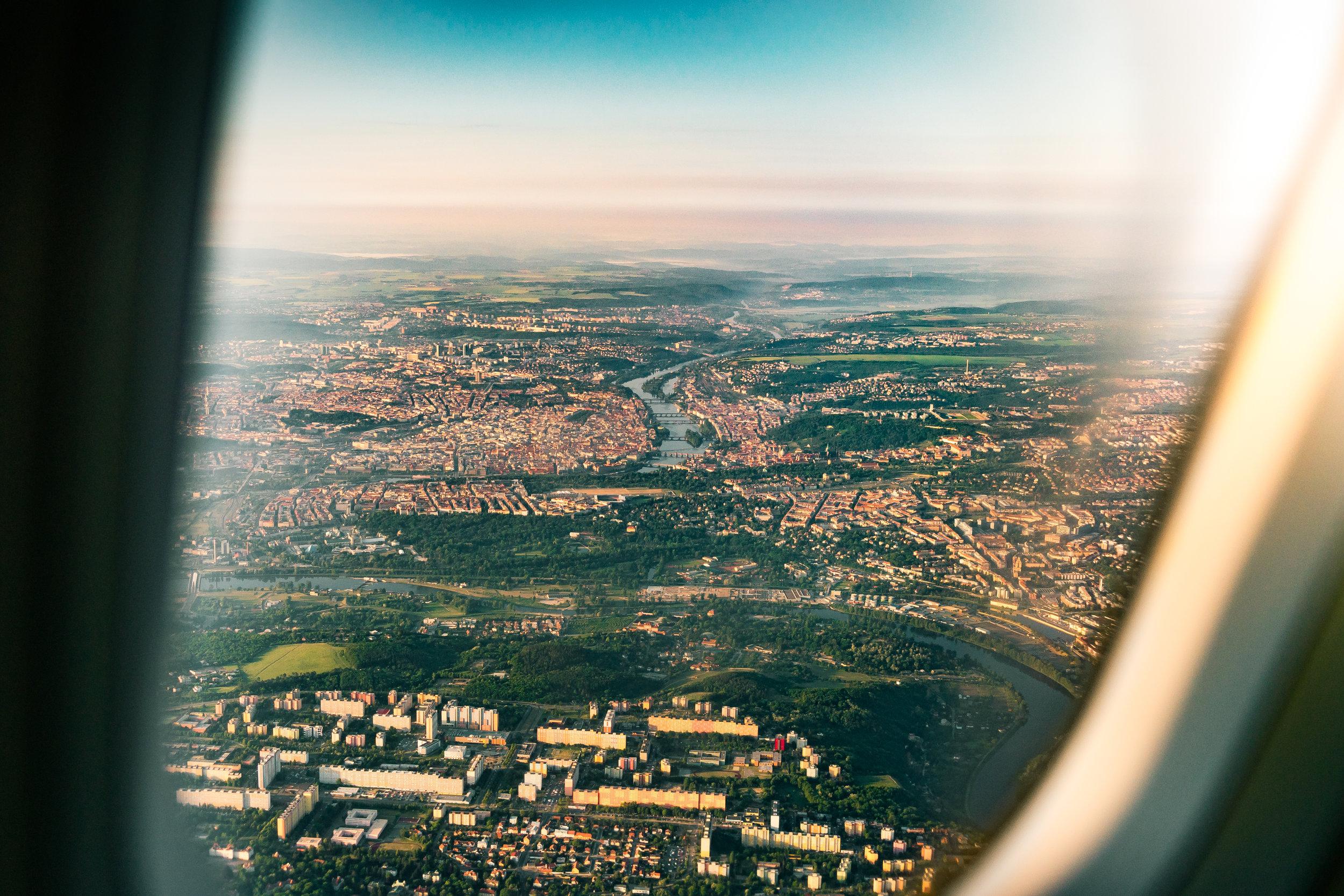 Photo of Prague through and aeroplane window