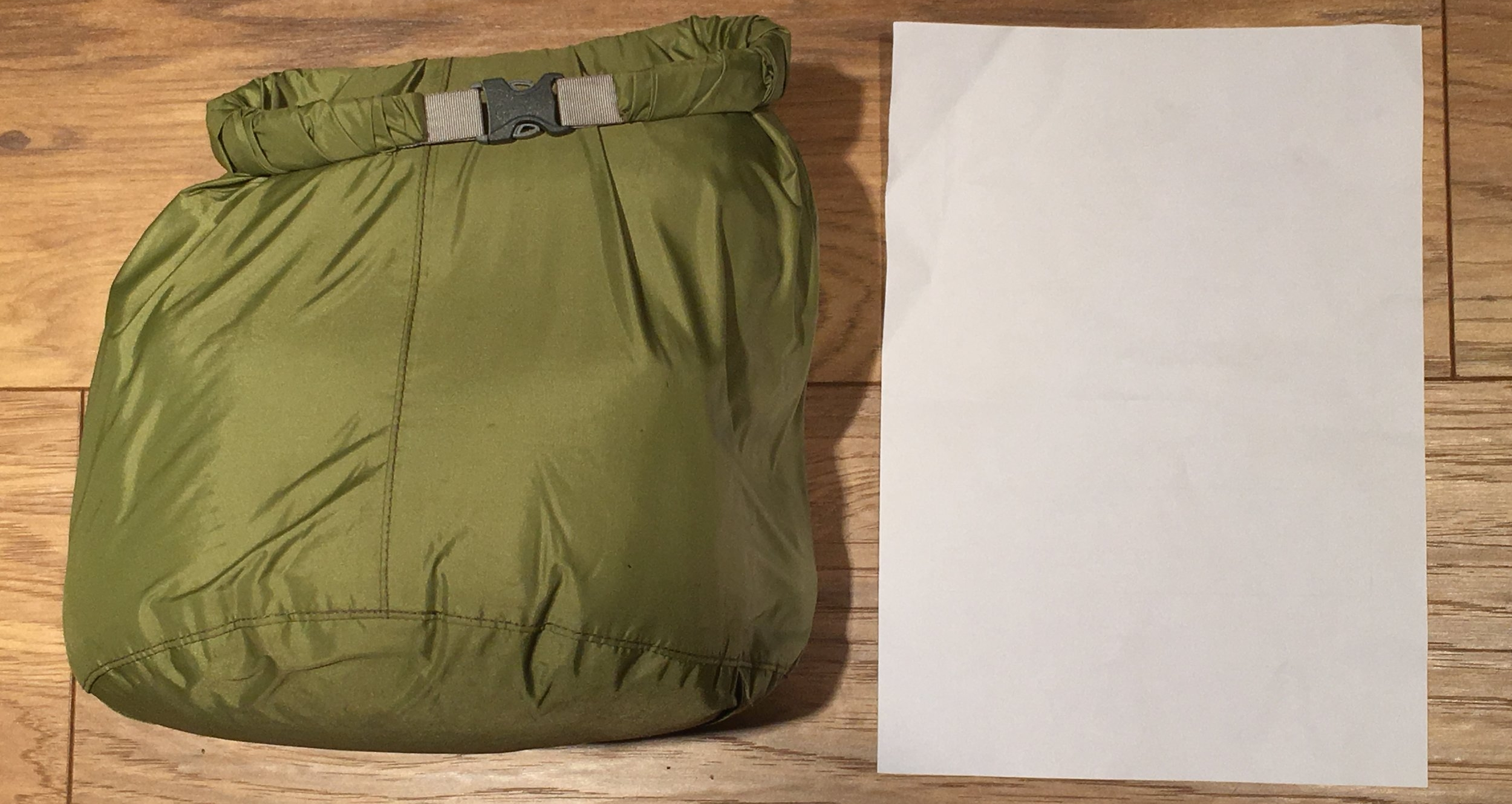 The Ditch Kit - All packed up (A4 page for scale). This lives in my day pack whilst canoeing, with my spare clothes in the larger portage pack. That way should I capsize and only be able to recover one of my packs, I'll be still be able to change into a dry set of clothes.