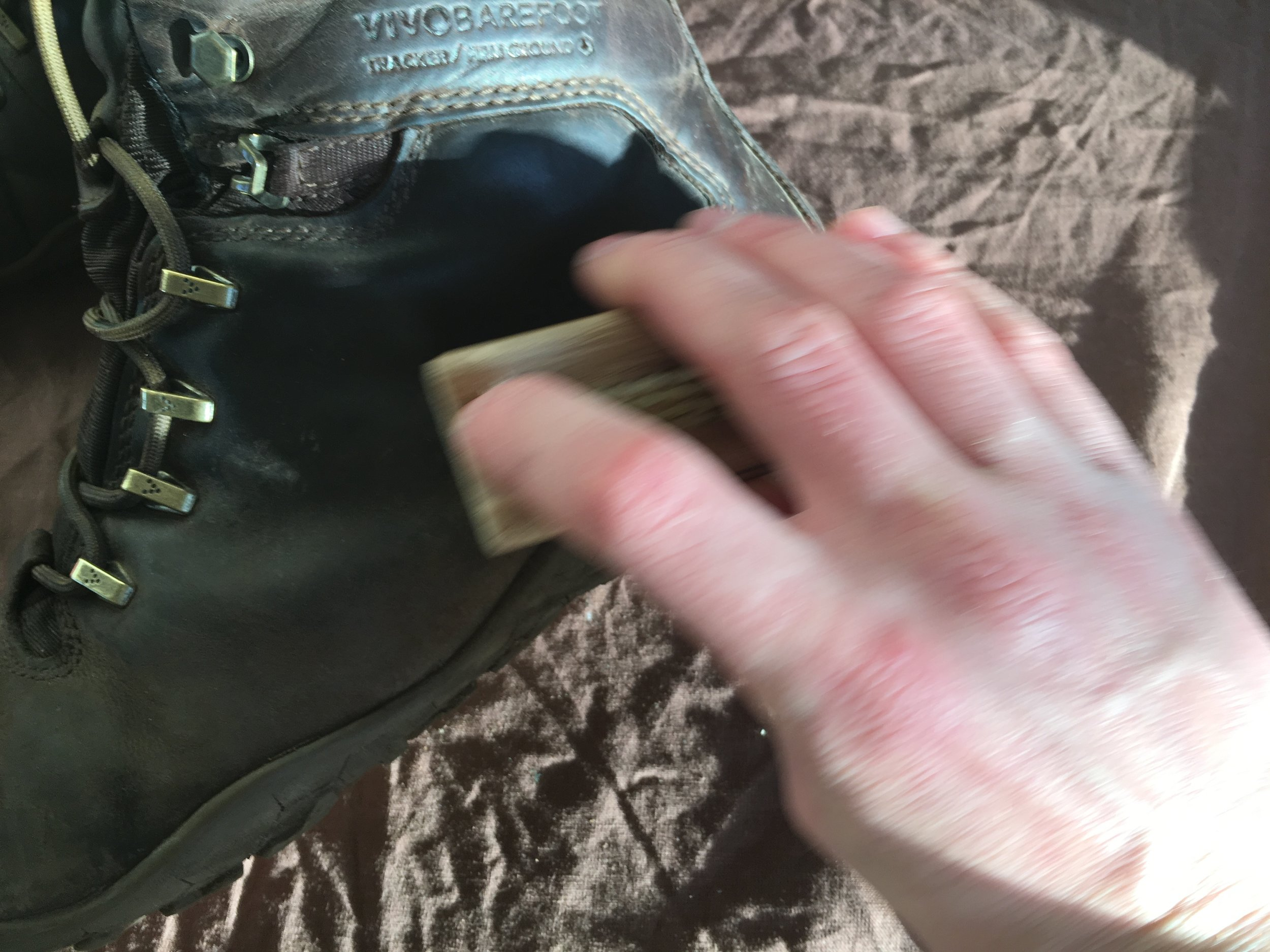 brush boot to remove built up dirt