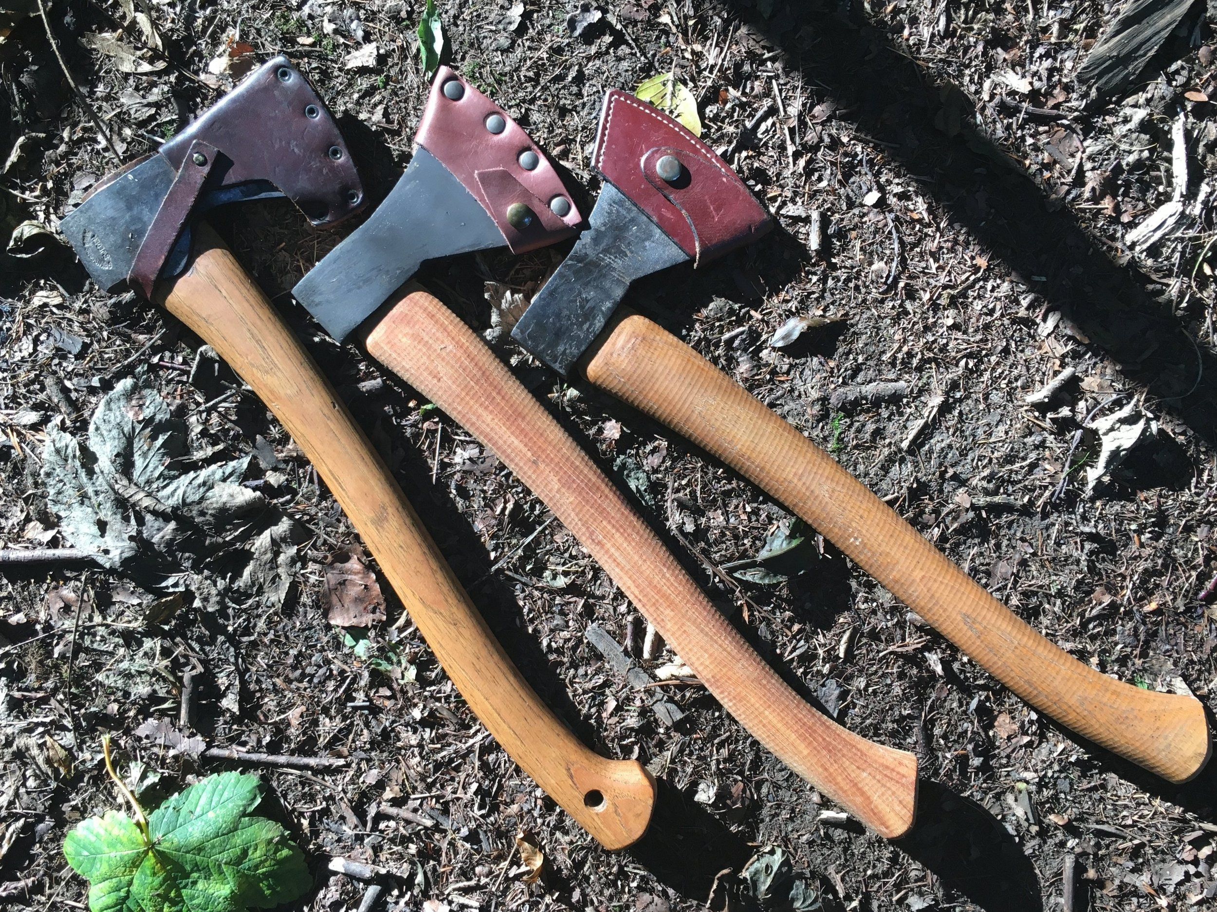A GB Small Forest, Bushcraft Axe and Sheath, and Bushcraft Axe Prototype....