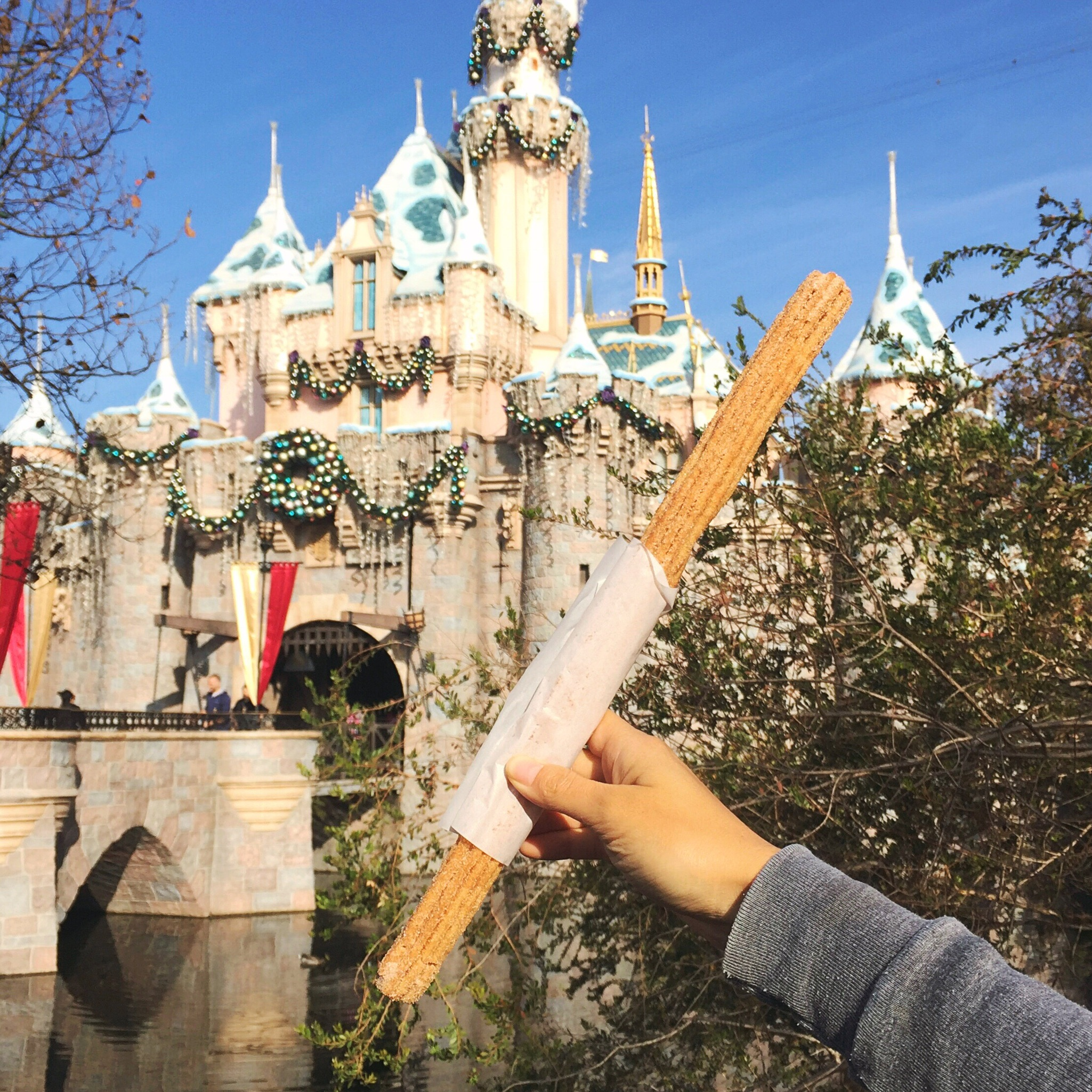 Disneyland churro with its only packaging, a square of parchment paper.