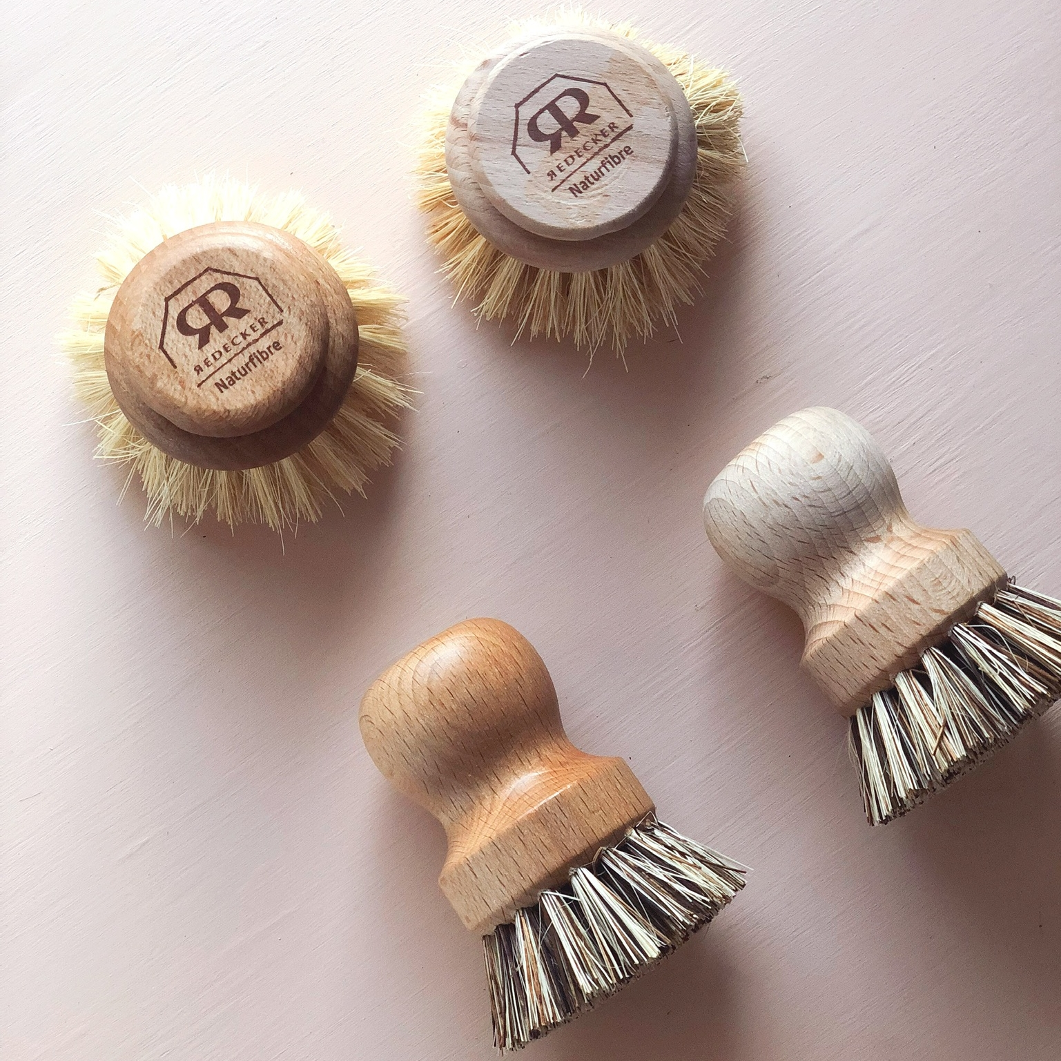 The brushes on the left have a layer of spoon butter, the brushes on the right are bare.
