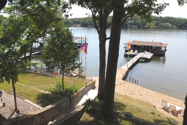 the view from the deck looks out onto the lake and the fishing dock.