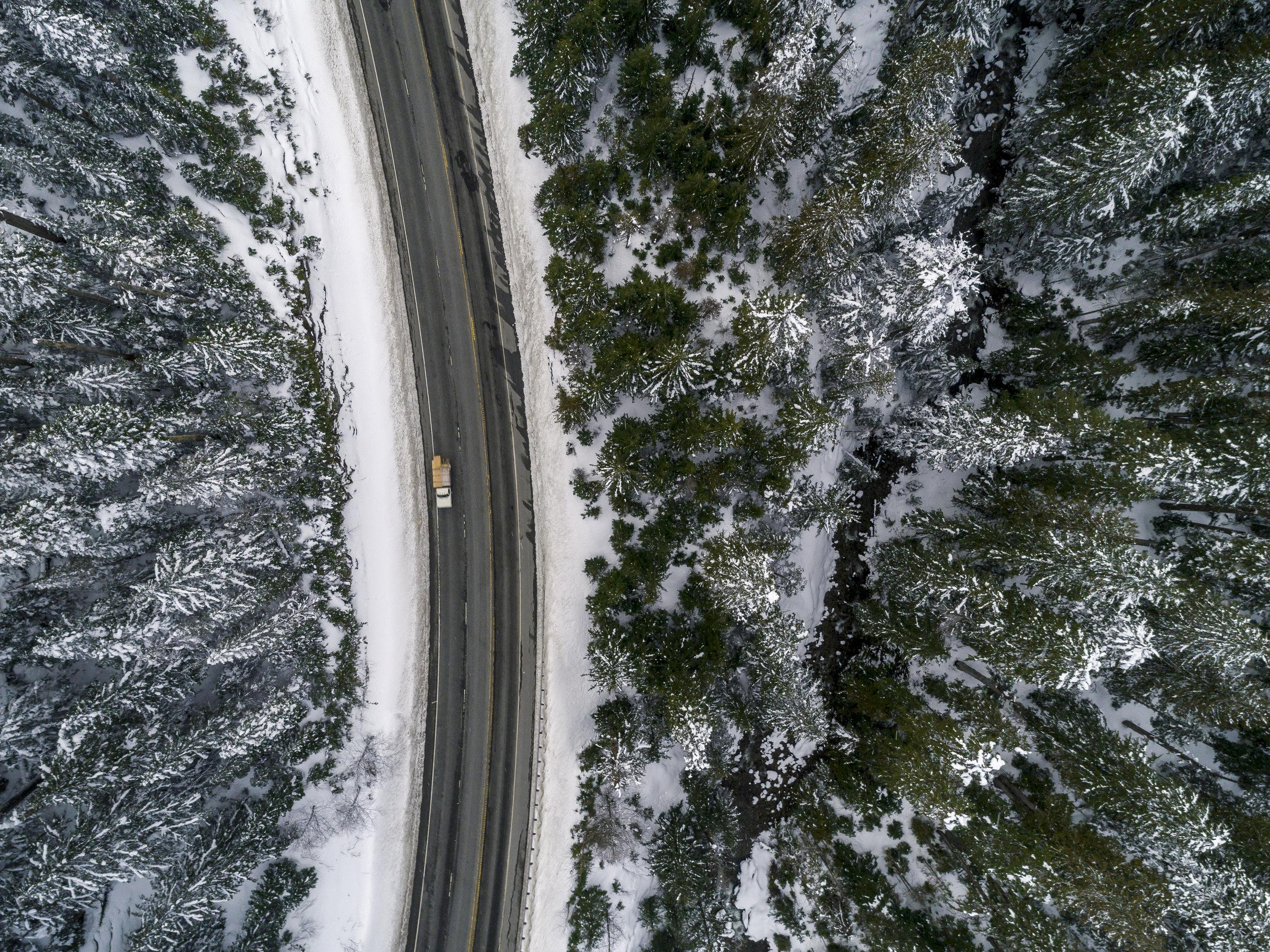 Pacific_Northwest_Overhead_Snowy_Highway_Aerial.jpg