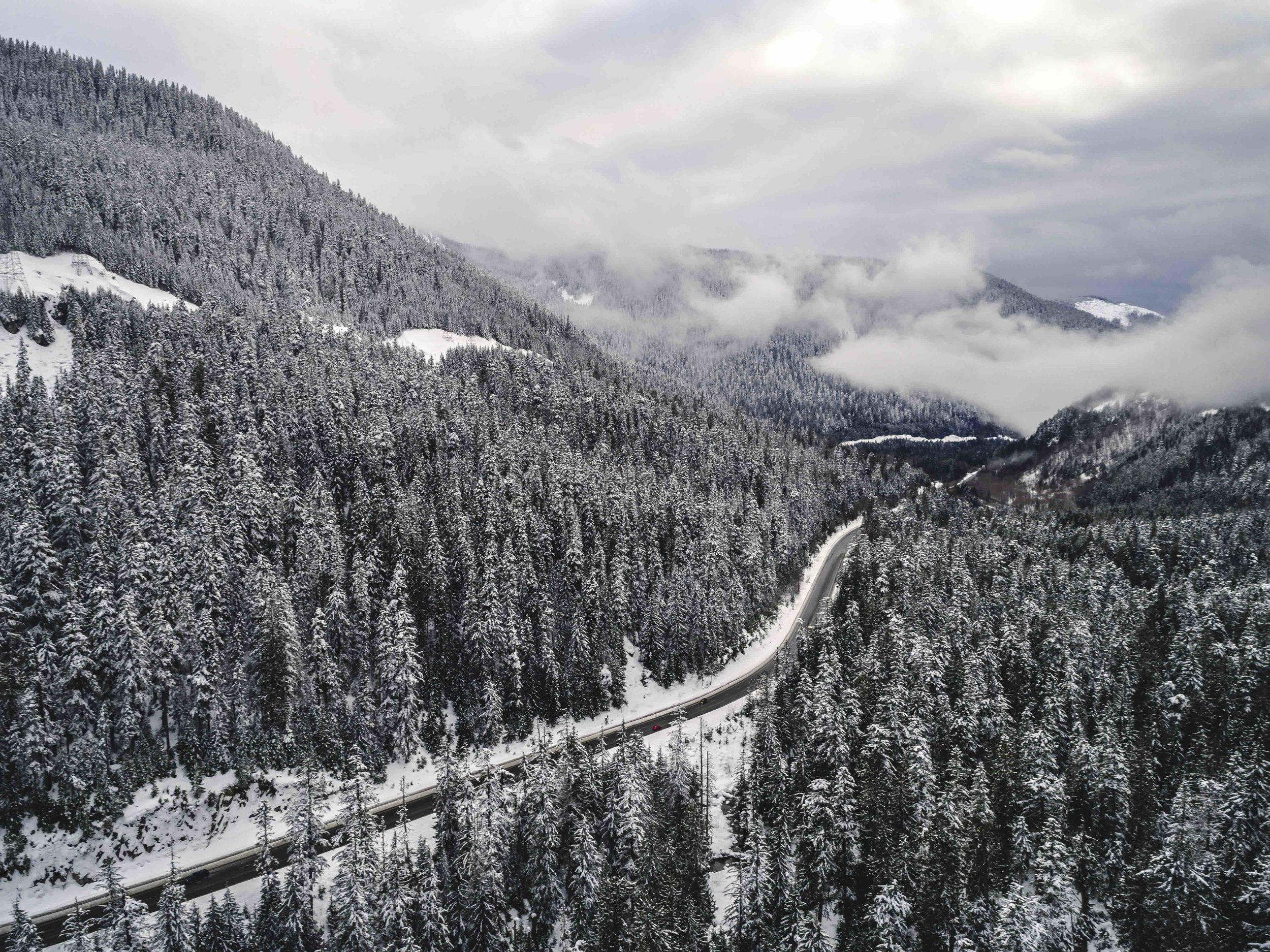 Snowy_Stevens_Pass_Washington_Mountain_Highway_Aerial.jpeg