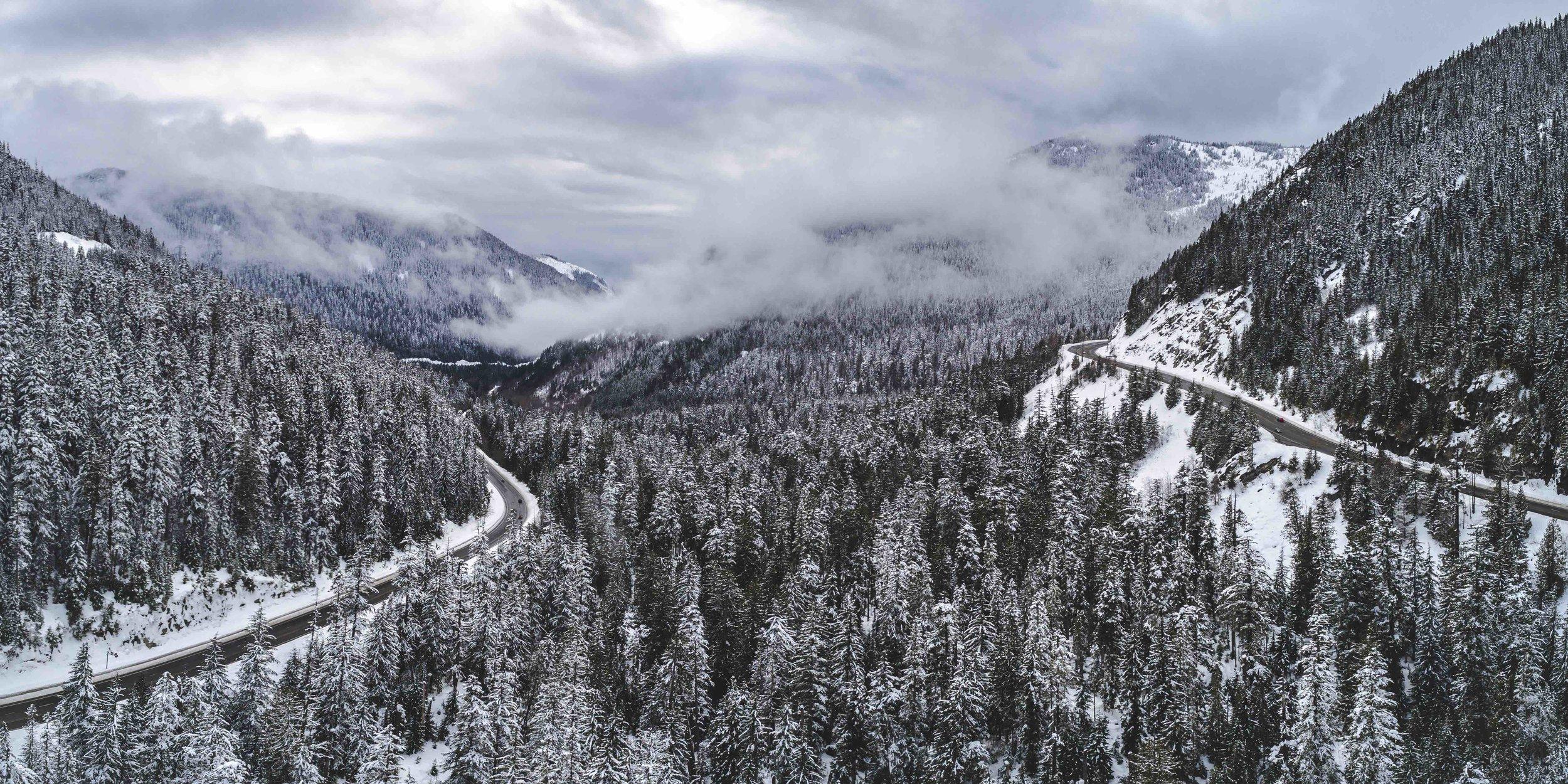 Wilderness_Adventure_Mountain_Highway_Snowy_Aerial_Background.jpeg