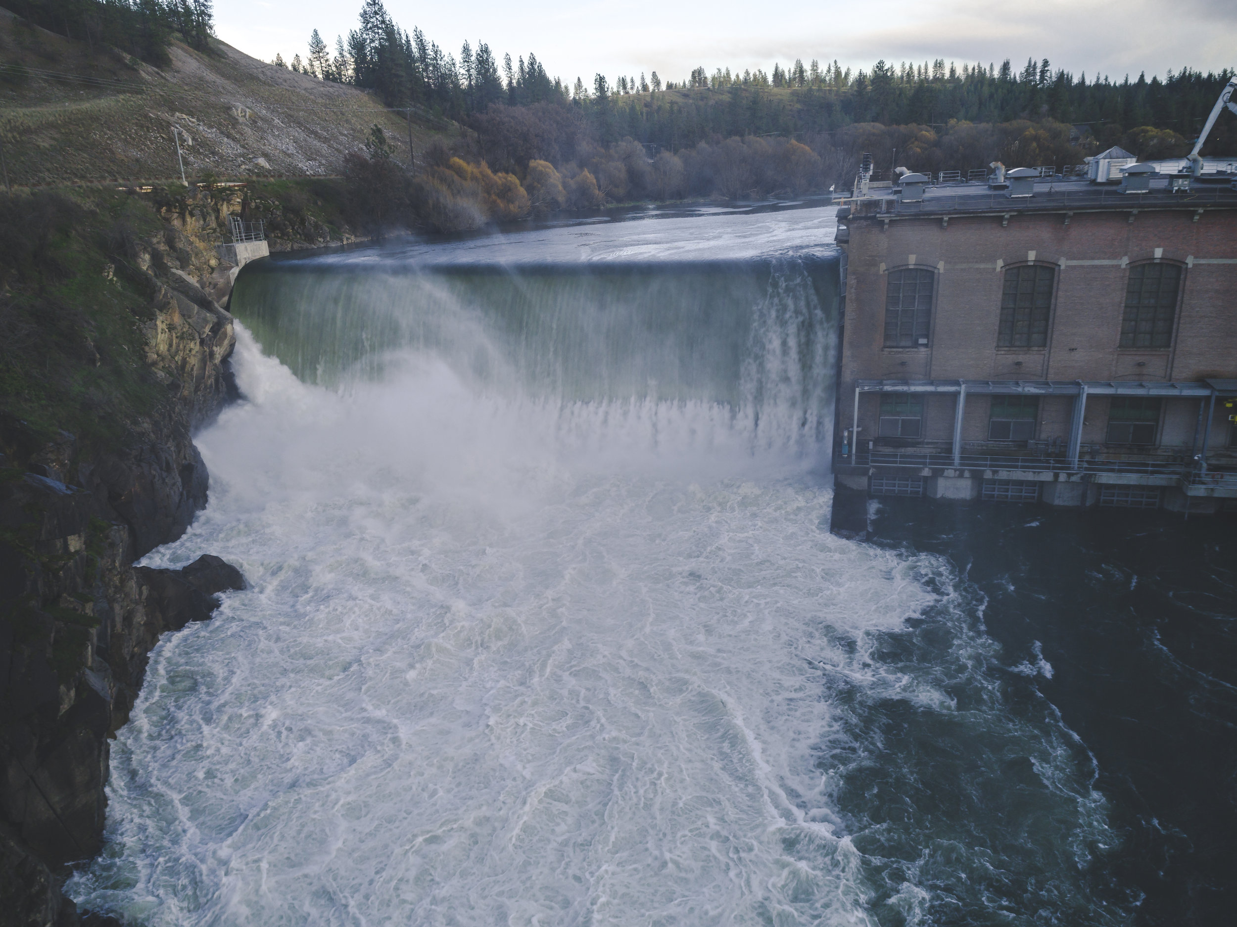 Dramatic_Old_Dam_Building_Waterfall_Aerial.jpg