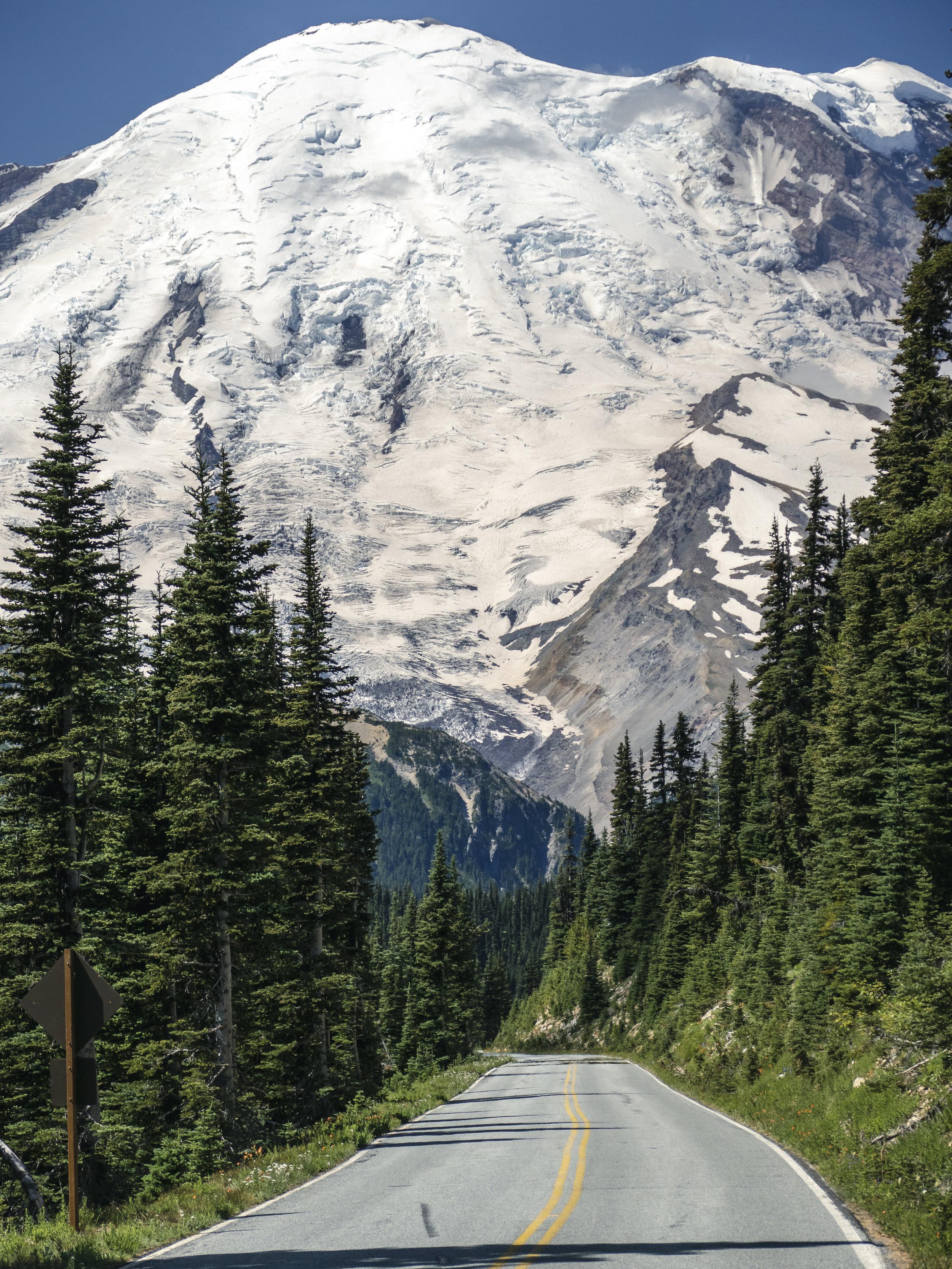 Massive_Mt_Rainier_Glacier_Above_Mountain_Road_in_Washington_State.jpg
