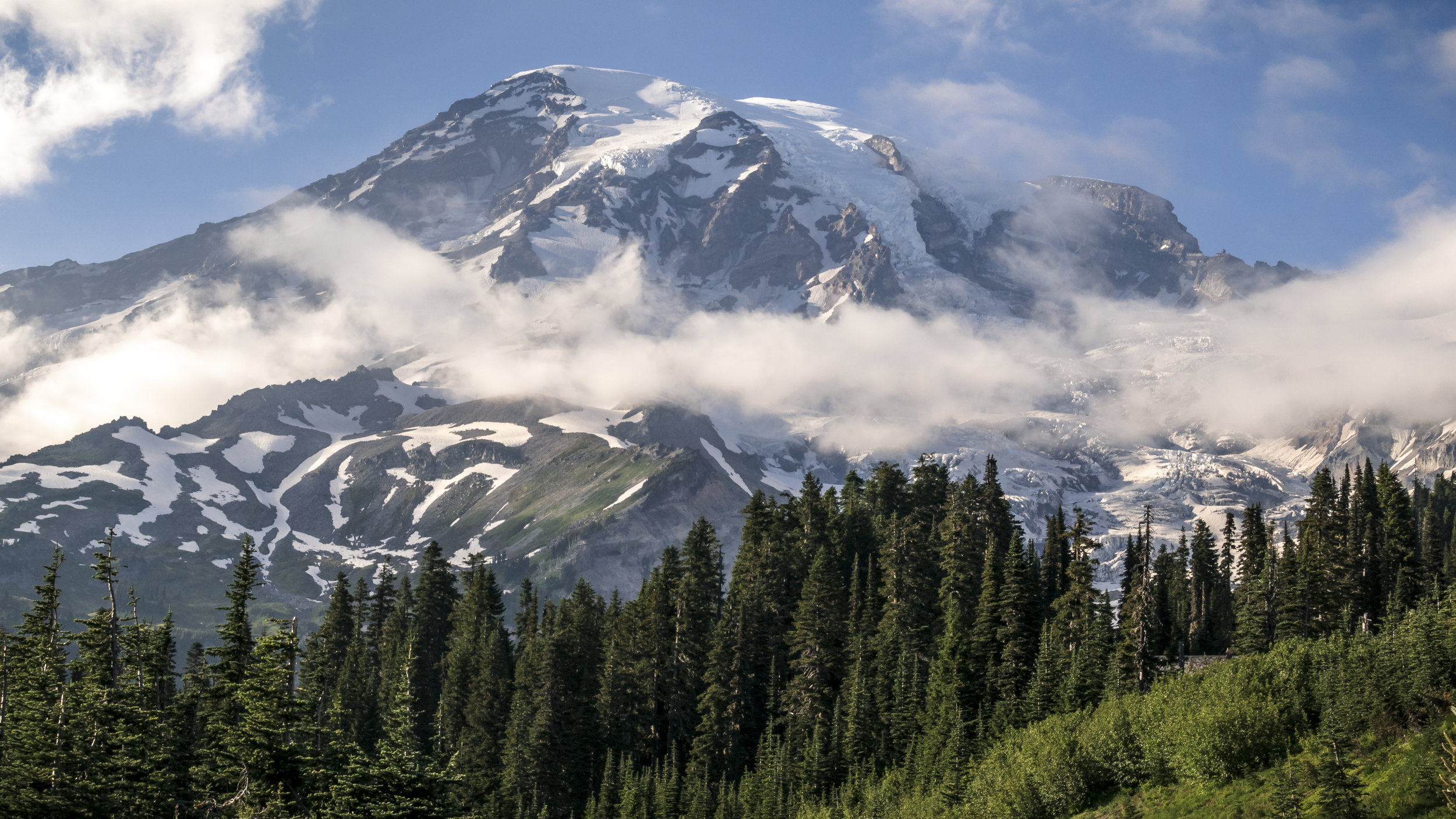 Sunny_Day_View_of_Mt_Rainier_from_Popular_Summer_Hiking_Trail.jpg