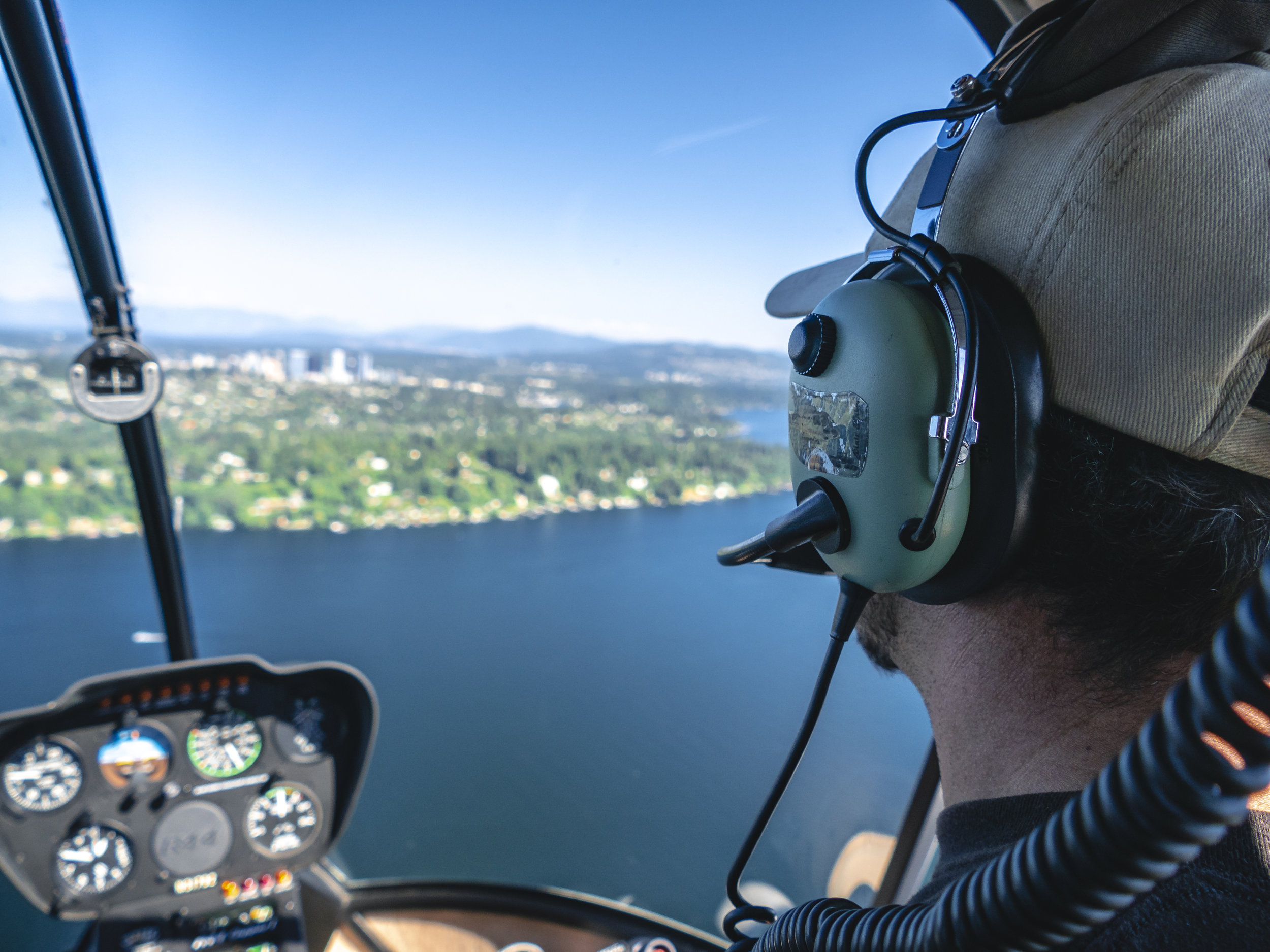 Helicopter_Pilot_Over_the_Shoulder_View_Flying_Above_Water.jpg