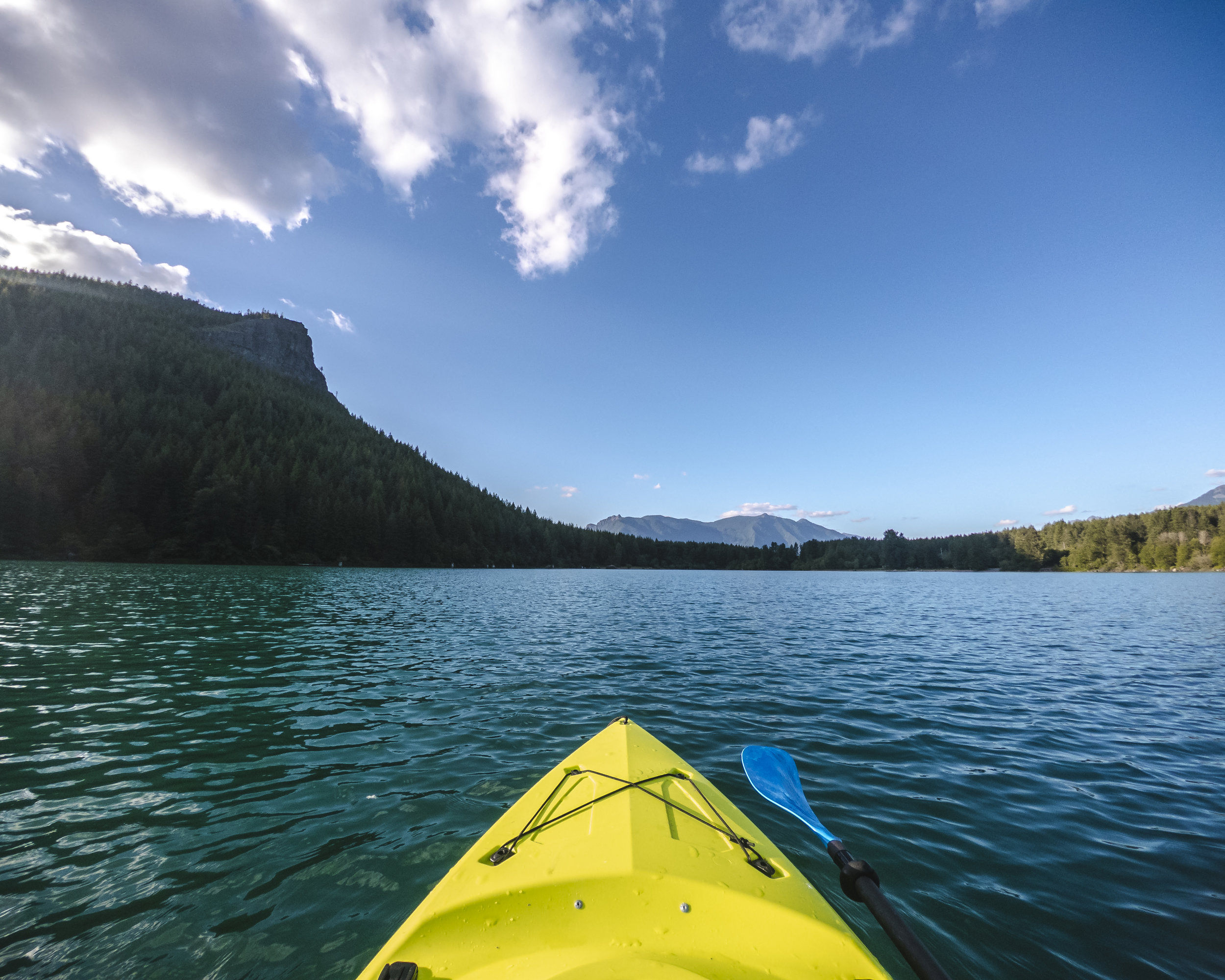 Kayak_Boat_Point_of_View_on_Turquoise_Mountain_Lake_Water.jpg