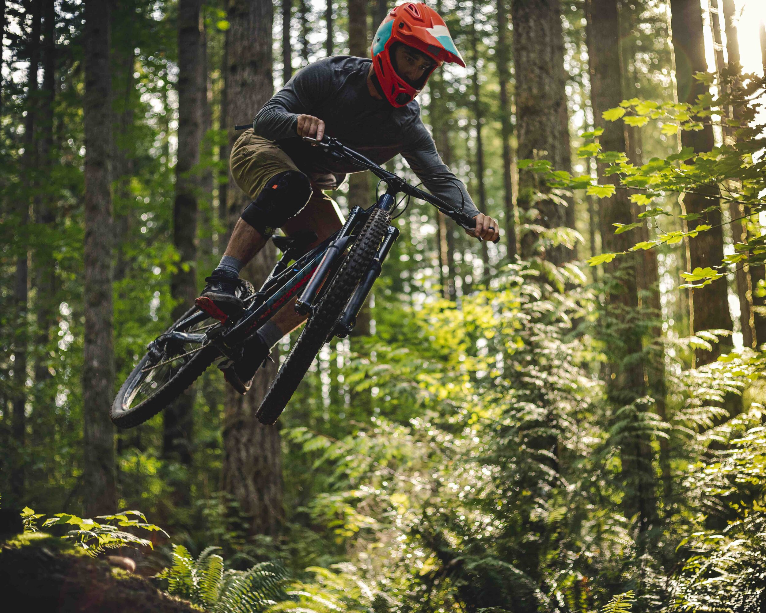 Intense_Mountain_Bike_Riding_Catching_Air_on_Forest_Trail.jpeg