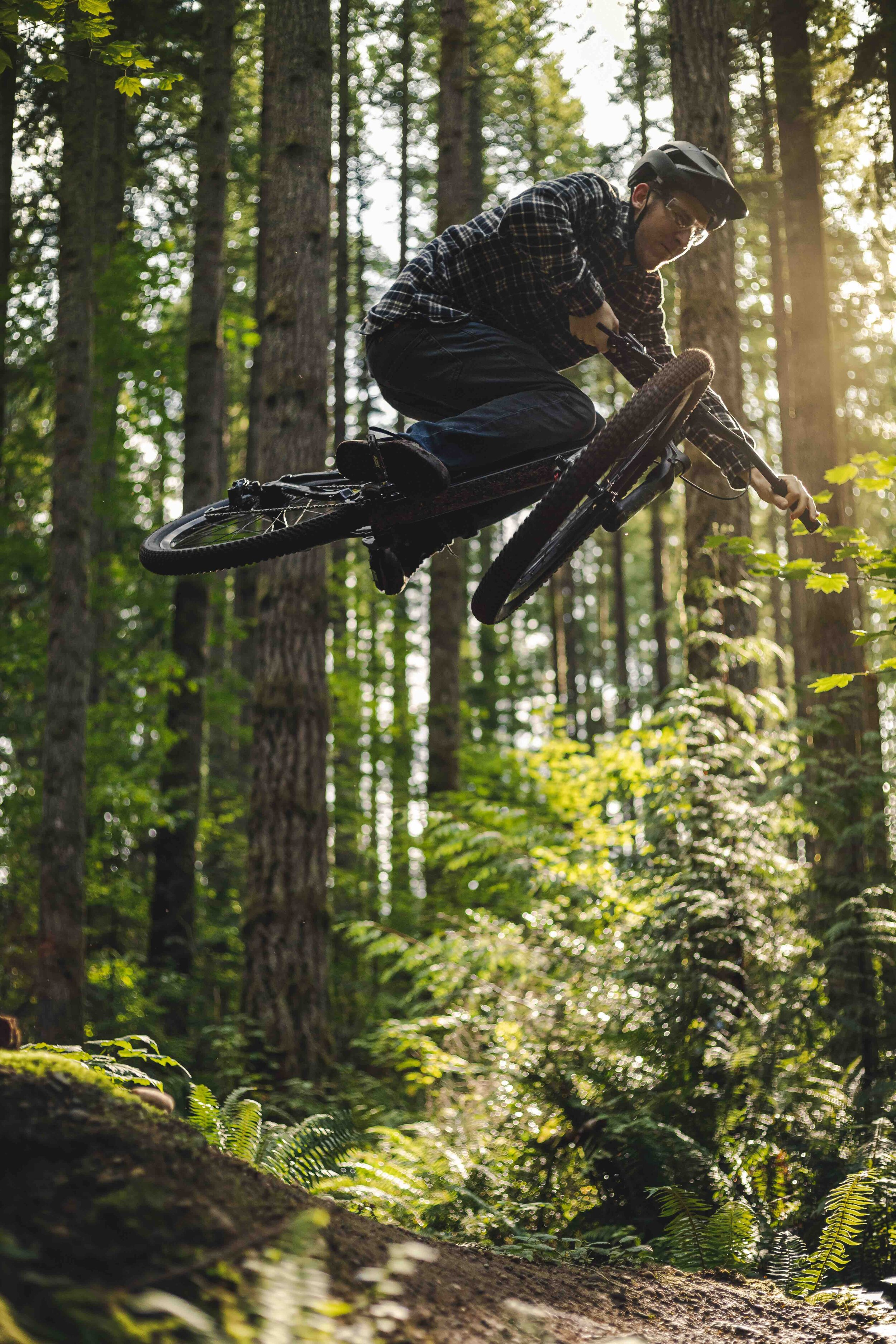 Amazing_Mountain_Bike_Jump_Trick_in_Forest_with_Golden_Hour_Lighting.jpeg