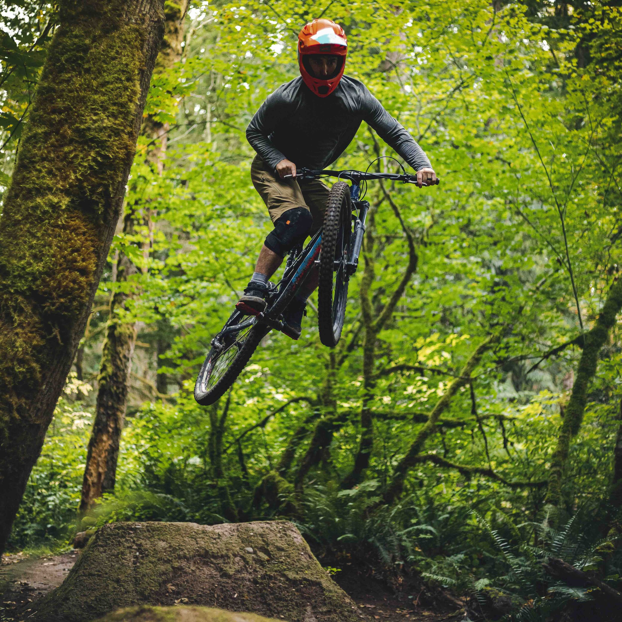 Extreme_Sports_Athlete_Catching_Air_on_Forest_Mountain_Bike_Jumps.jpeg