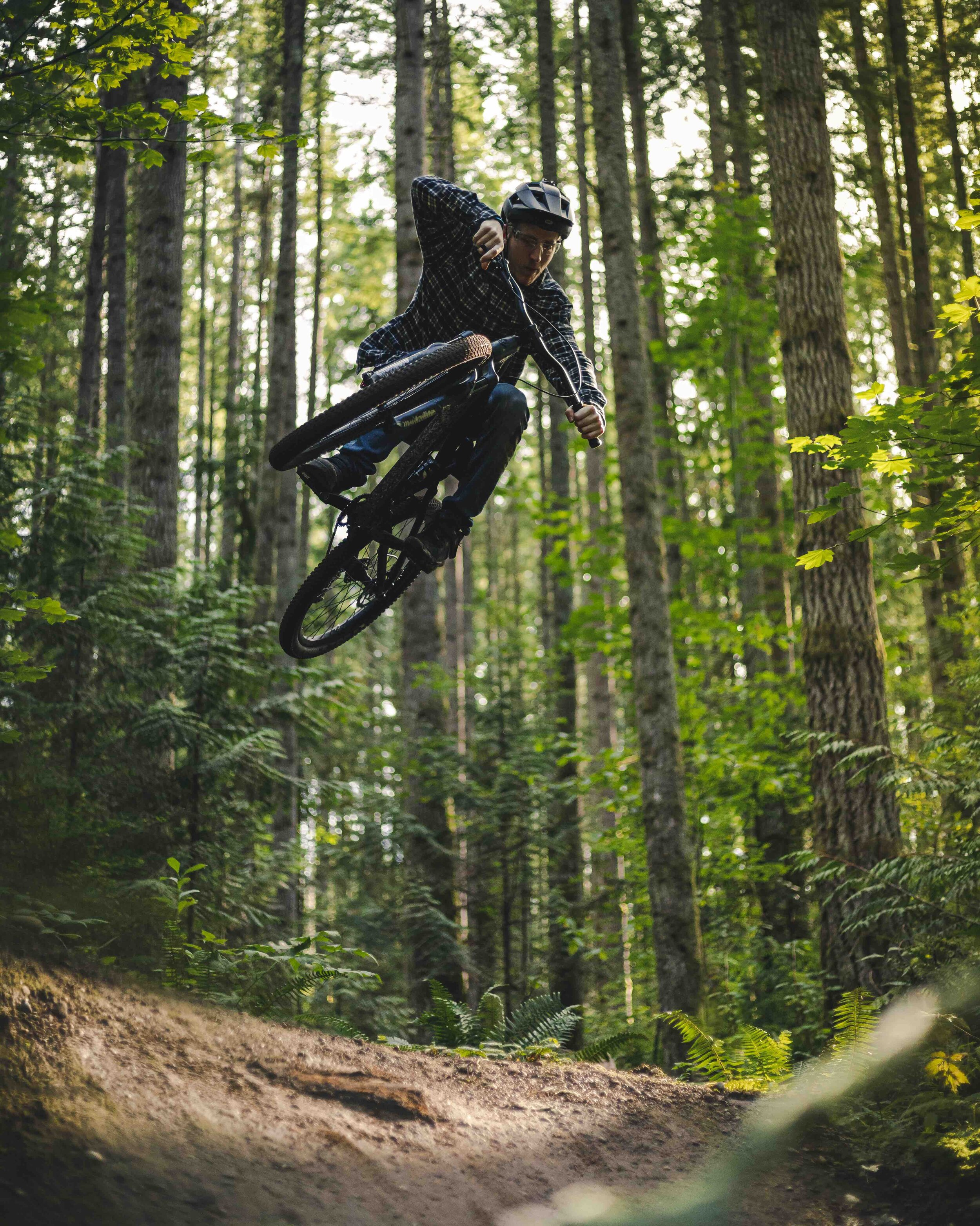 Stylish_Mountain_Bike_Jump_Trick_Catching_Air_in_Forest.jpeg