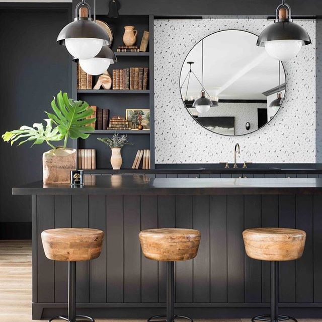 Really into the wood tones against the black cabinetry. Also, love that they used a large round mirror in this kitchen since I just finished doing the same thing in a project! Swipe to see the drawing from my latest kitchen design!