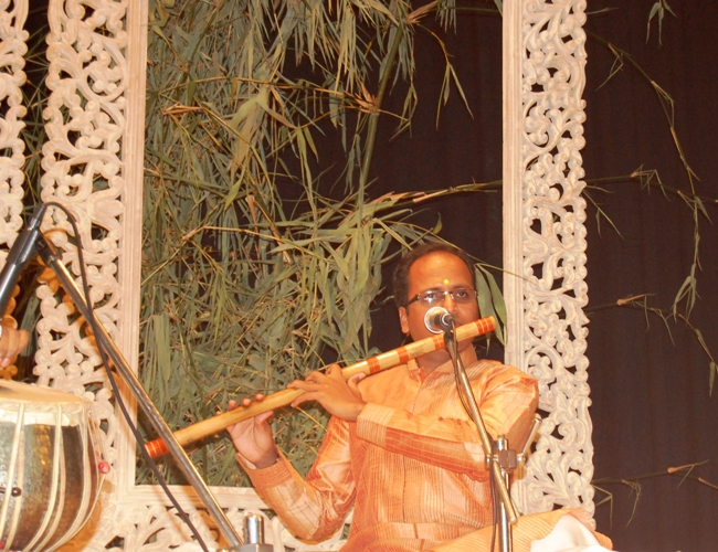 Himanshu Nanda charming the audience with the meldious flute tunes.JPG