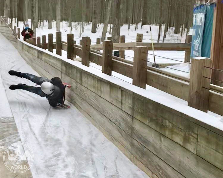 This luger repeatedly tried to overpower his sled rather than working with it. And he repeatedly wiped out. Muskegon Winter Sports Complex, Michigan. #luge #openwidetheworld