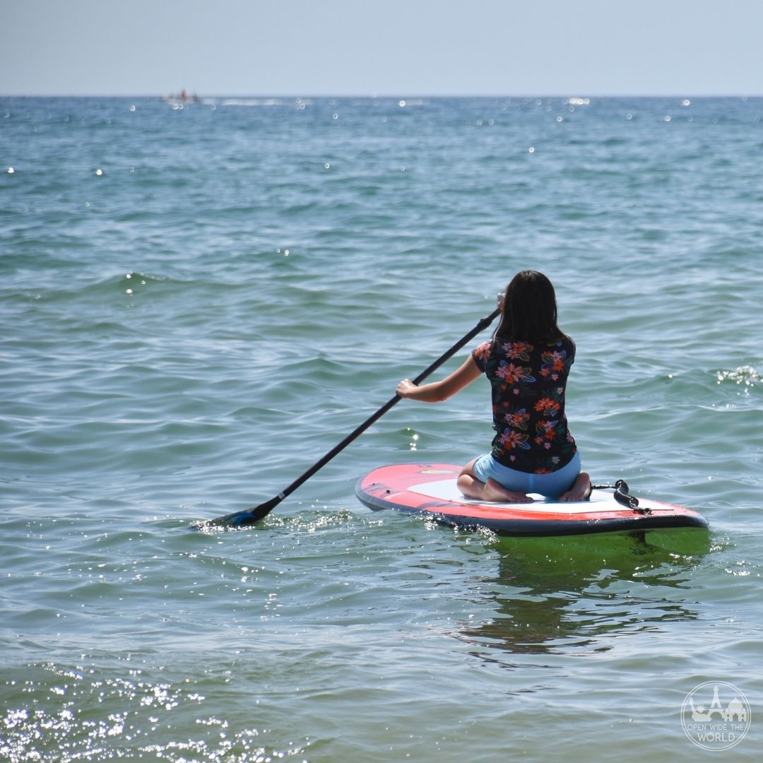 Mag getting some board comfort during her first time on a SUP. Great Lakes Surf Festival, Muskegon, Michigan.