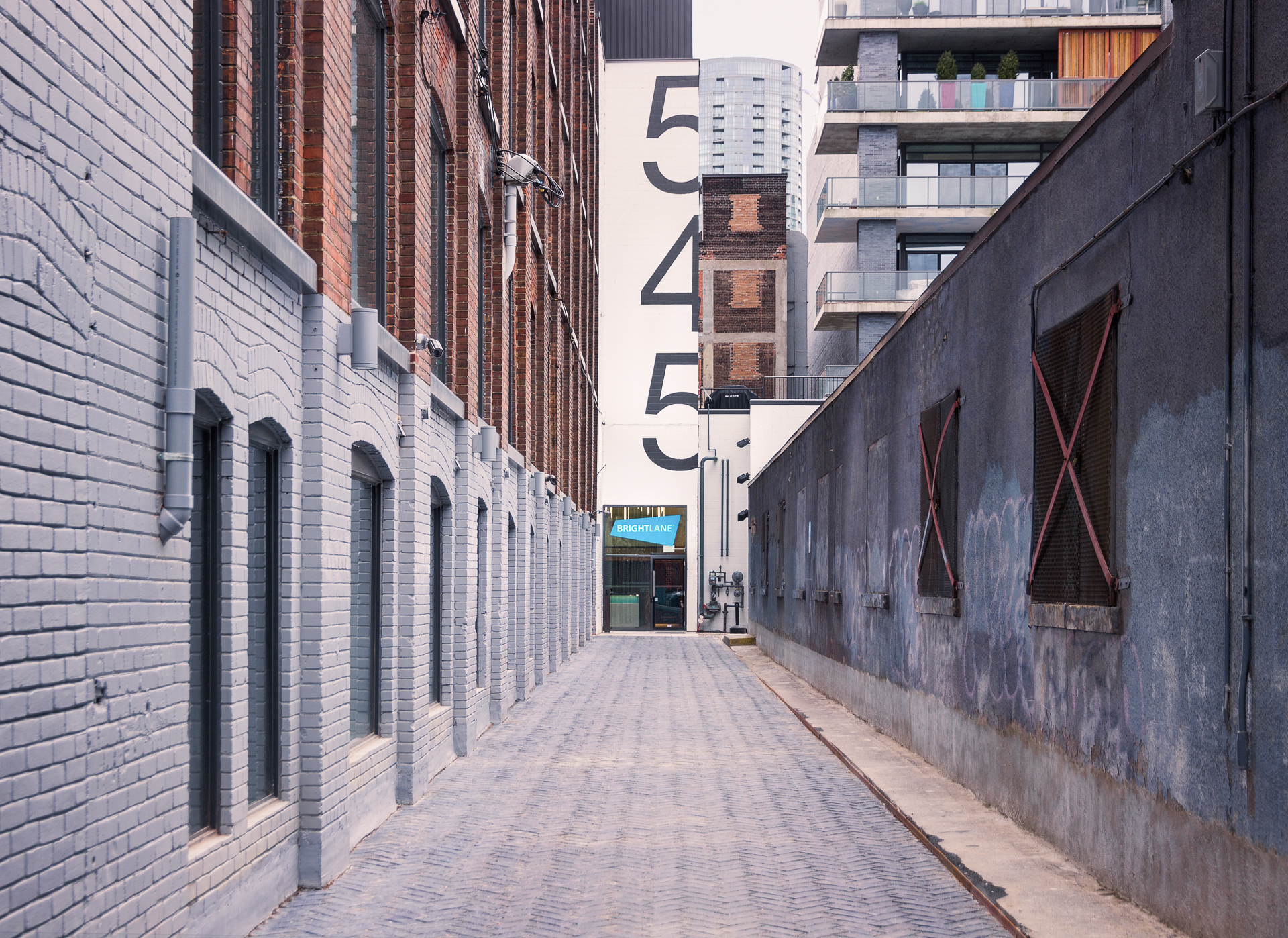 The escape game uses the same door as Brightlane Inc. Look for a long alleyway with a huge 545 on the back wall, walk to the end of it, call the number and we'll receive you at the door.