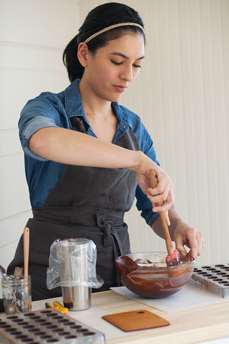 Chocolatier Melissa Santos making ganache to fill chocolates.